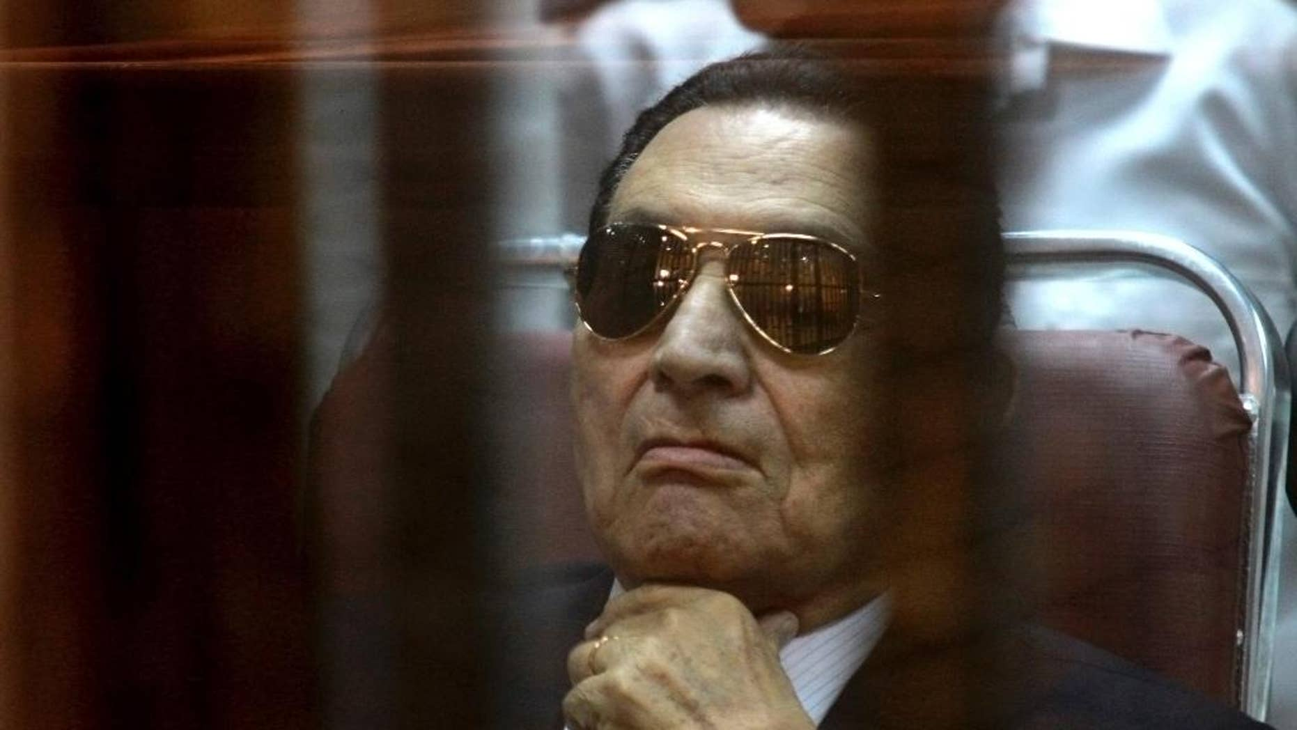 April 26, 2014: In this file photo, ousted Egyptian President Hosni Mubarak attends a hearing in his retrial over charges of failing to stop killings of protesters during the 2011 uprising that led to his downfall, in the  Police Academy-turned-court in the outskirts of Cairo, Egypt.  (AP)