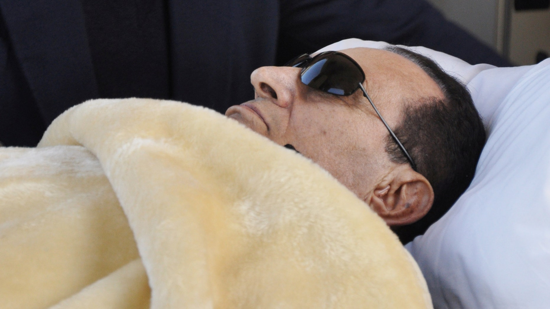 FILE - former Egyptian President Hosni Mubarak is wheeled into court in Cairo, Egypt.