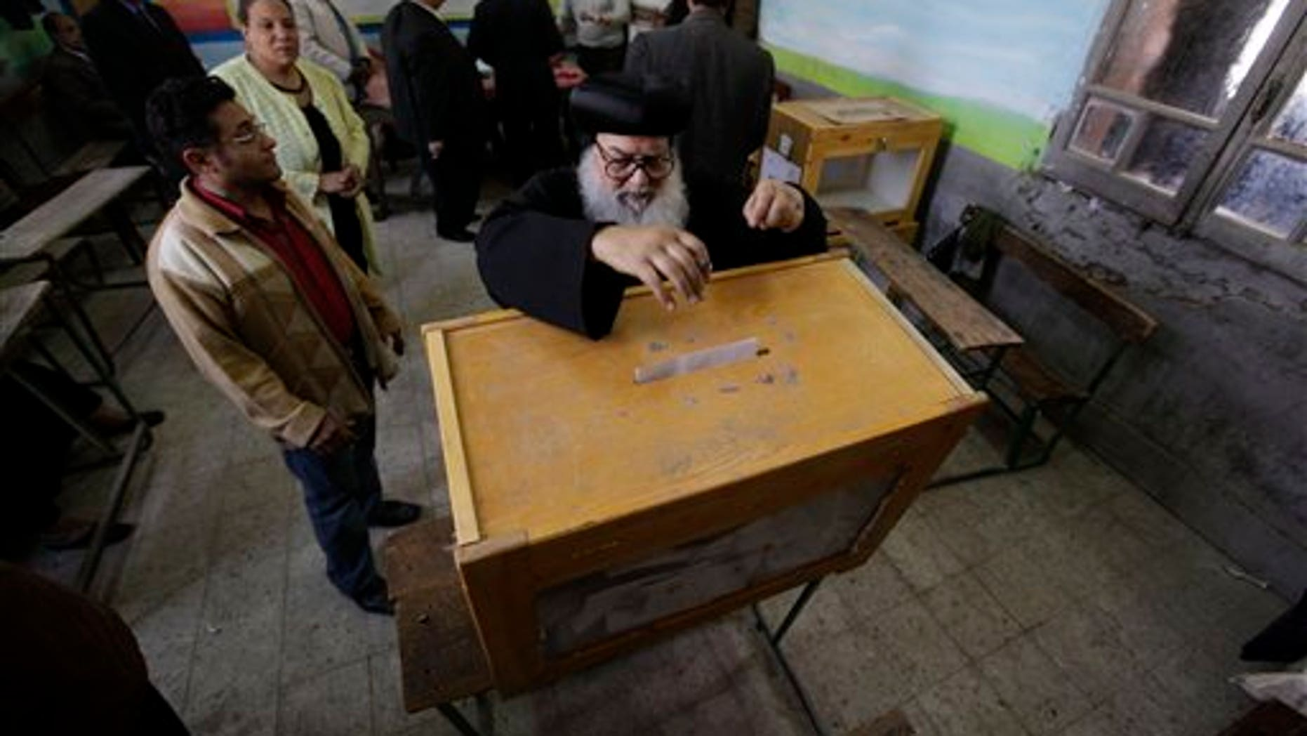 March 19: An Egyptian priest casts his vote at a polling station in Cairo, Egypt on referendum on constitutional amendments. (AP)