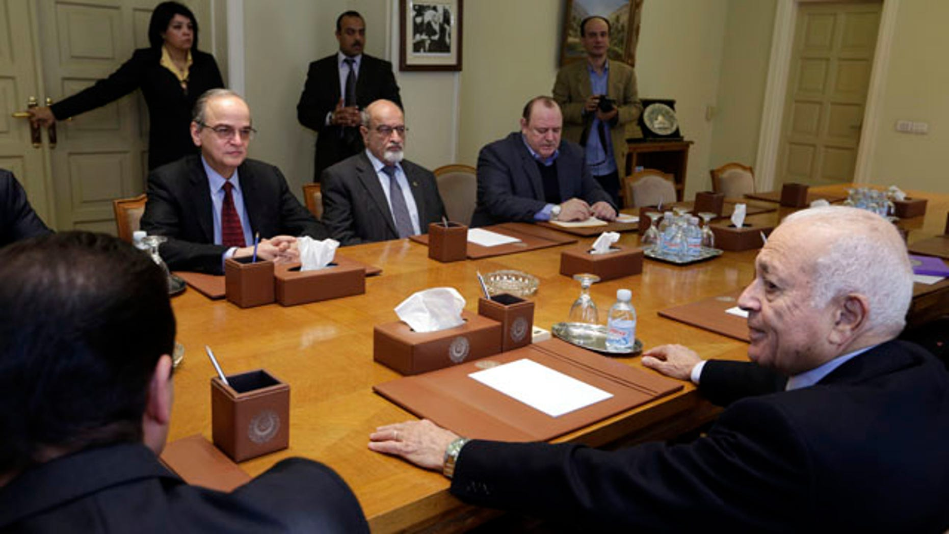 Dec. 27, 2014: The Arab League's Secretary-General Nabil Elaraby, right, meets with Hadi Bahra, the head of the Syrian National Coalition, the country's main political opposition group, left, and Haitham al-Maleh, a member of the group, second left, at the league's headquarters in Cairo. (AP Photo/Amr Nabil)