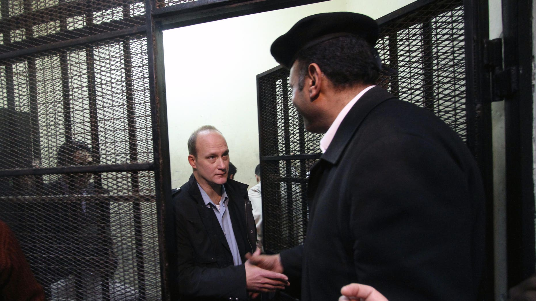 Mar. 8, 2012: American Robert Becker of the National Democratic Institute leaves the defendants' cage after a hearing in the trial of employees of nonprofit groups in Cairo, Egypt.