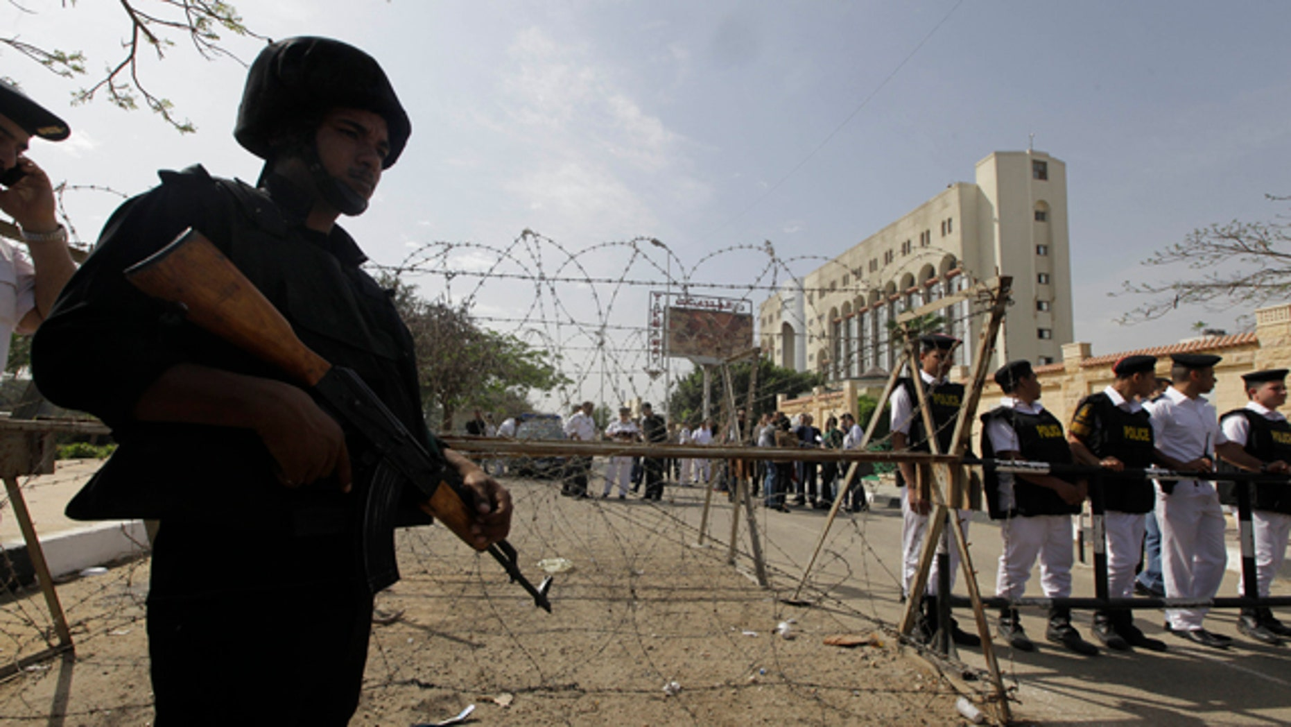 April 19, 2014: Egyptian soldiers stand guard outside the election commission office in Cairo. (AP Photo/Amr Nabil)
