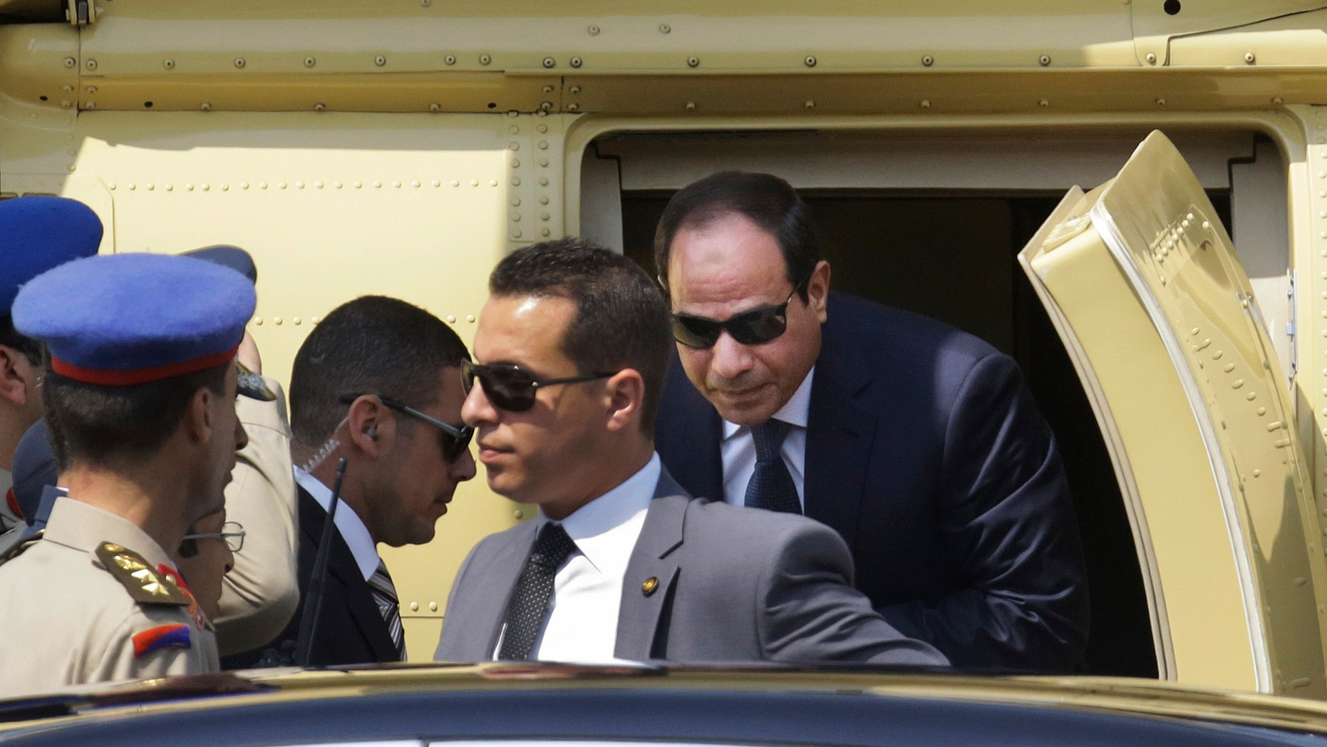 June 8, 2014 - Egyptian President-elect Abdel-Fattah el-Sissi gets out of a military helicopter as he arrives at the Supreme Constitutional Court, to take the oath of office in Cairo, Egypt.