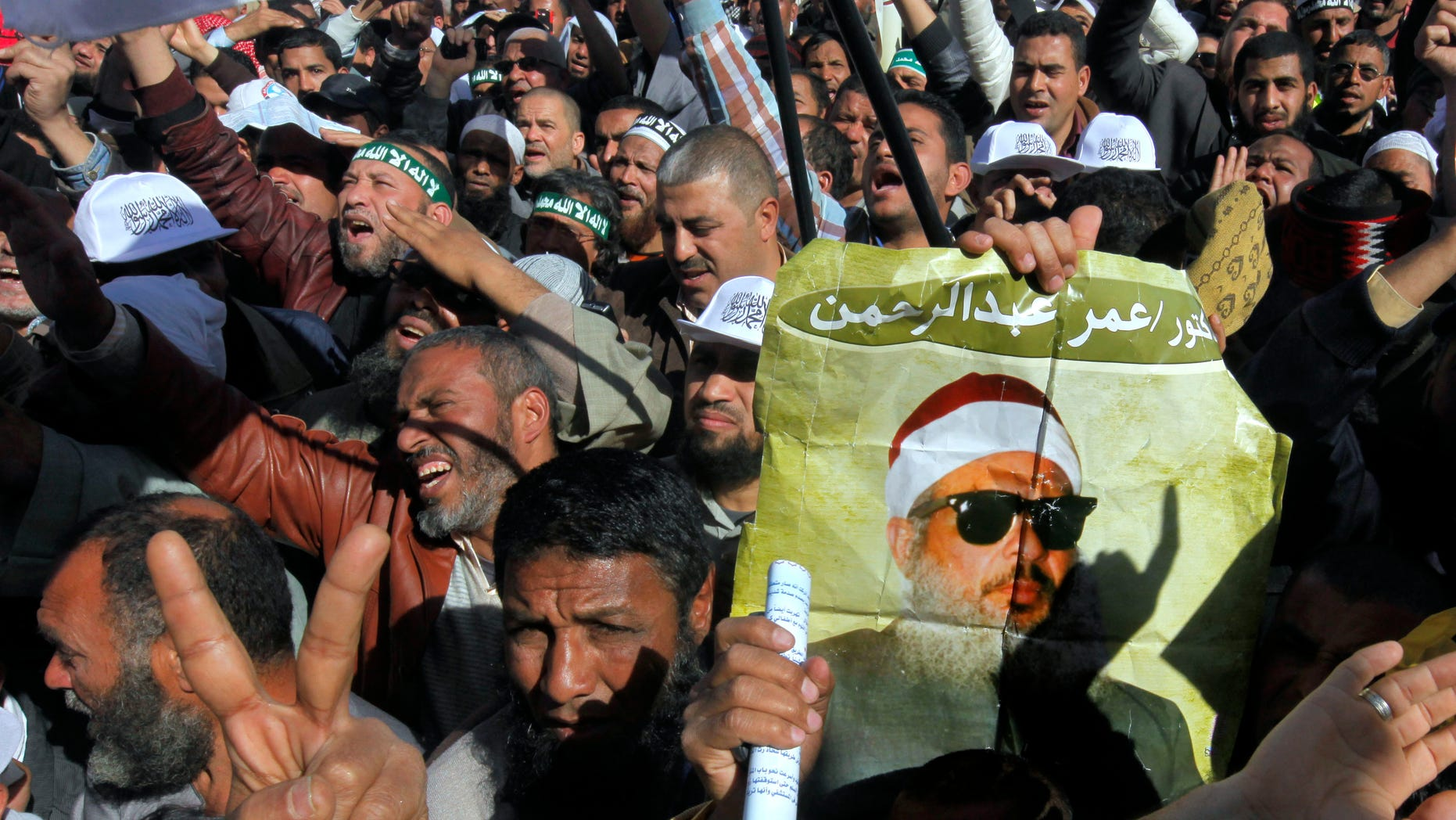 Feb. 15, 2013: Supporters of Sheik Omar Abdel-Rahman, a blind Egyptian cleric jailed in the United States for planning a campaign of bombings, call for his release  while one demonstrator holding a poster with his image, during a rally outside Cairo University in Cairo, Egypt.