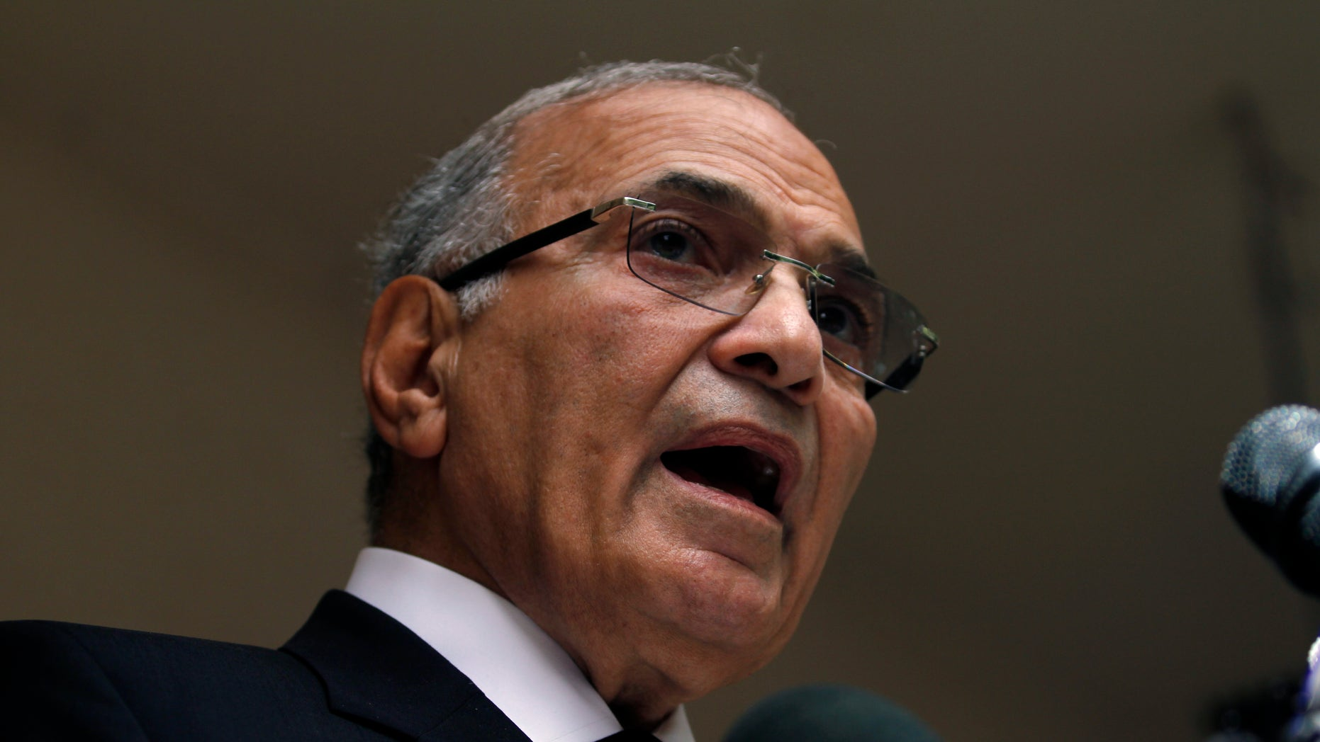 FILE - In this Saturday, May 26, 2012 file photo, Egyptian presidential candidate Ahmed Shafiq speaks to the media during a press conference at his office in Cairo, Egypt. Egyptian officials said Tuesday, Sept. 11, 2012 that Hosni Mubarak's last prime minister, Ahmed Shafiq, has been referred to trial on corruption charges in a case involving the ousted leader's sons. (AP Photo/Khalil Hamra, File)