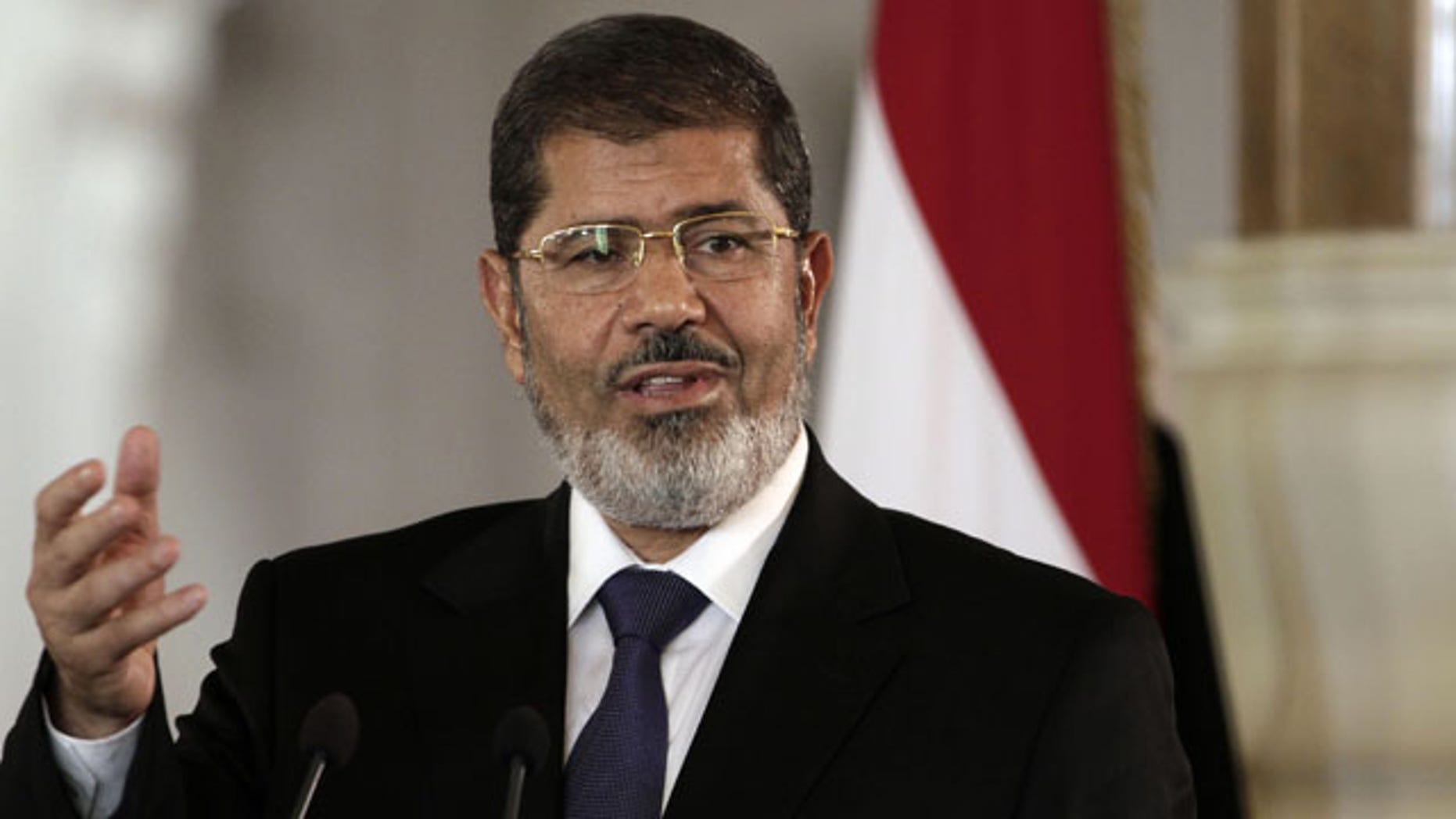 FILE - In this July 13, 2012 file photo, then Egyptian President Mohammed Morsi speaks to reporters at the presidential palace in Cairo. (AP)