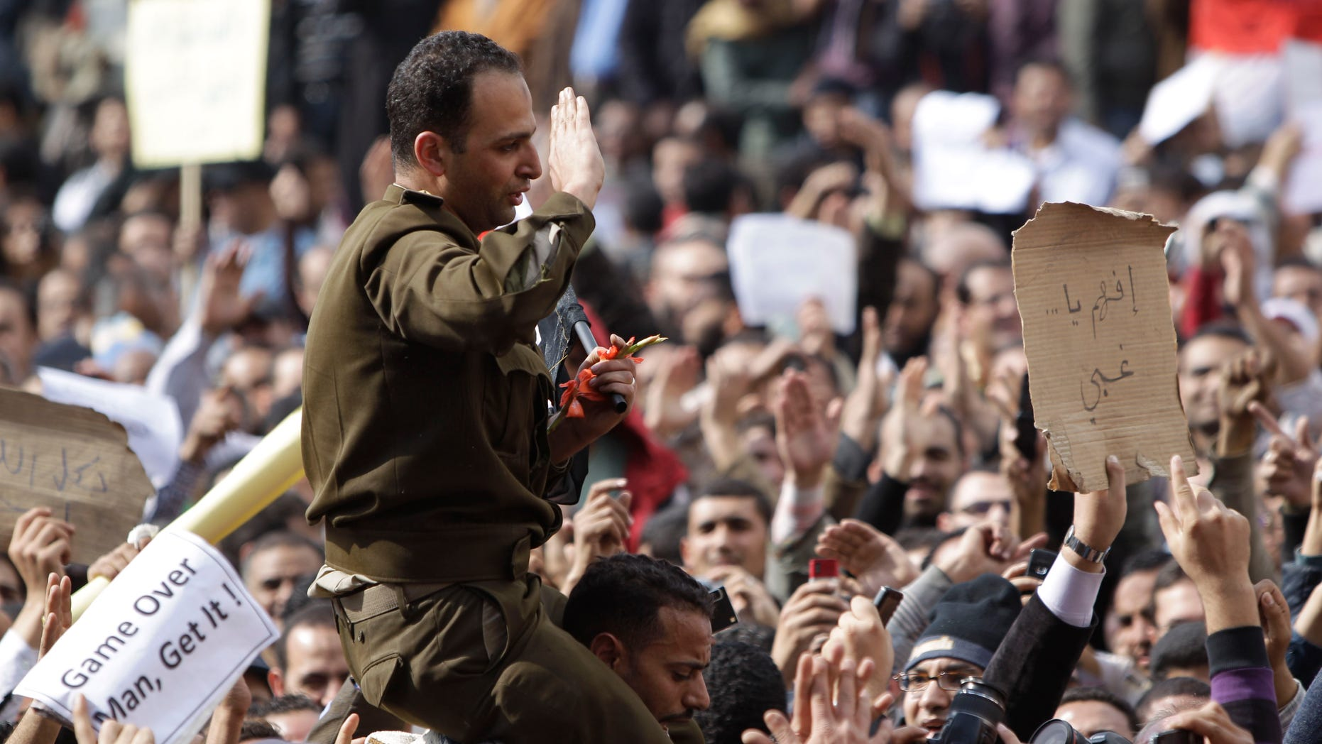 Jan. 31: A man identified only as Fathi, wearing the uniform of a captain in the Egyptian army, is carried by demonstrators on Tahrir, or Liberation Square, in Cairo, Egypt. A coalition of opposition groups called for a million people to take to Cairo's streets Tuesday to demand the removal of President Hosni Mubarak.