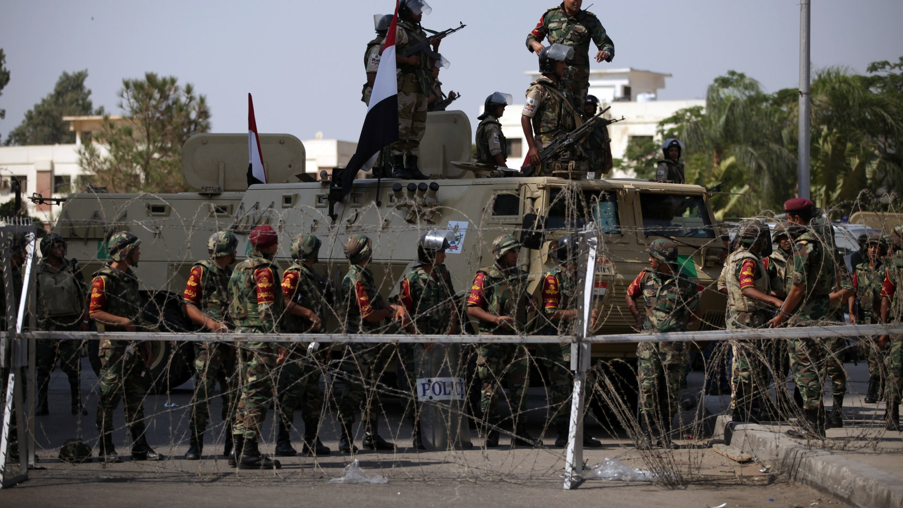 July 5, 2013 - Egyptian soldiers stand guard outside the Republican Guard building in Cairo, Egypt.