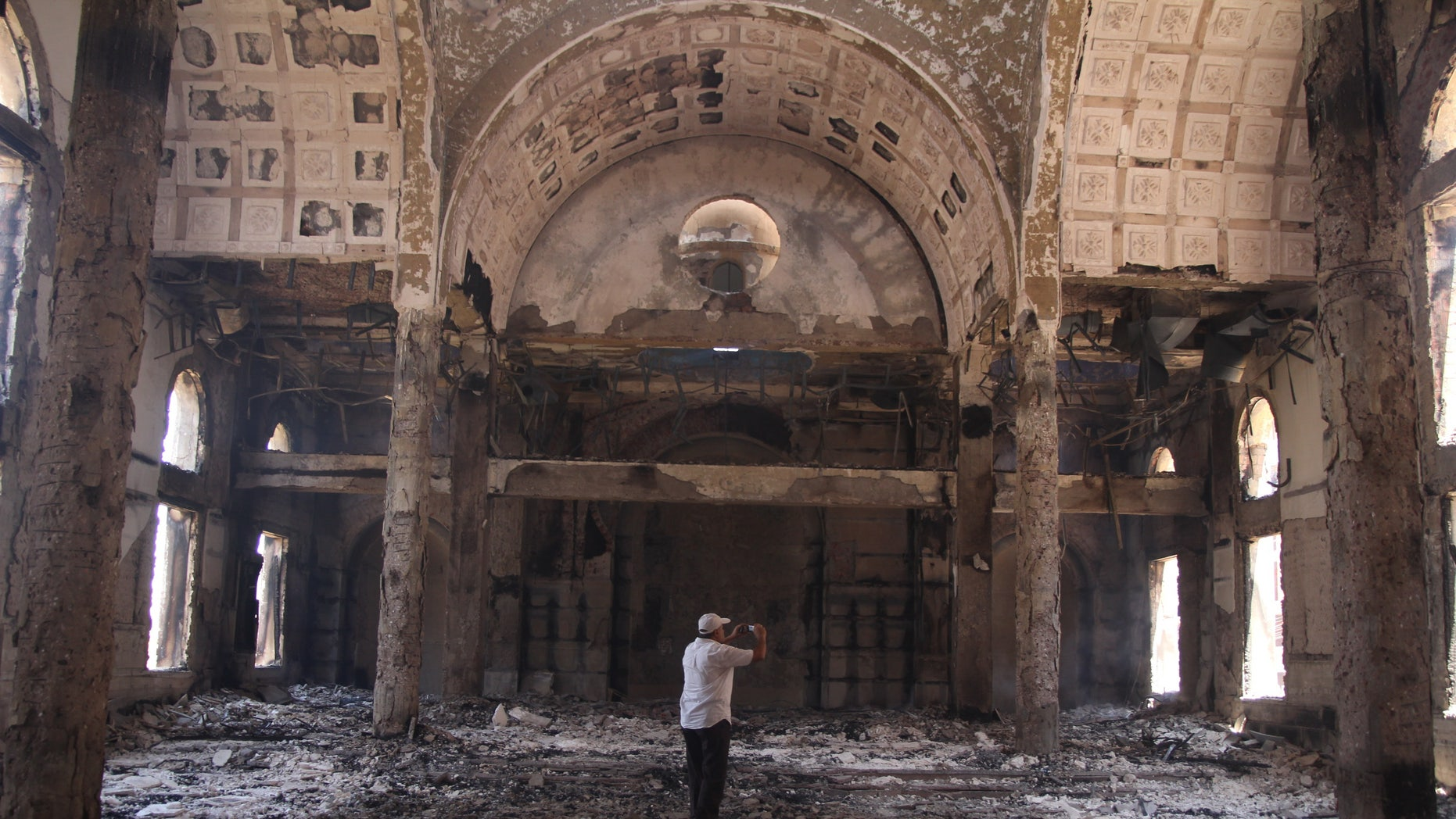 Aug. 15, 2013 - The damaged interior of the Saint Moussa Church after it was torched in sectarian violence following the dispersal of two Cairo sit-ins of supporters of the ousted Islamist President Mohammed Morsi, in Minya, south of Cairo, Egypt.