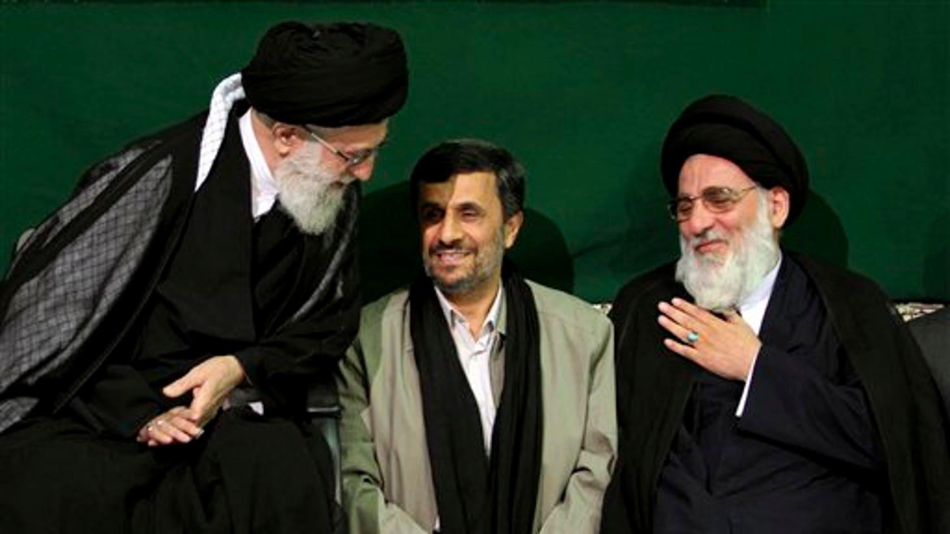 May 7, 2011: Iranian supreme leader Ayatollah Ali Khamenei, left, greets former Judiciary chief Ayatollah Mahmoud Hashemi Shahroudi, right, as President Mahmoud Ahmadinejad sits at center, during a religious ceremony, in Tehran, Iran.