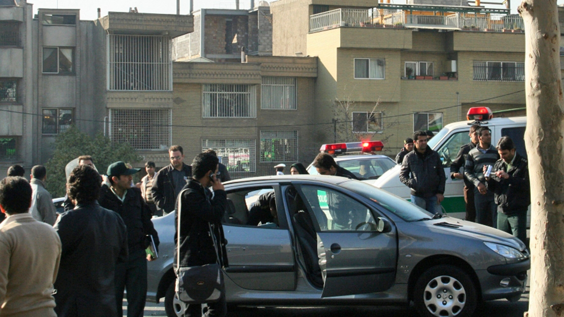 Nov. 29: This photo released by Fars News Agency is claimed by them to show one of the damaged cars following bomb attacks on the vehicles of two nuclear scientists in Tehran, Iran. State television reported assailants on motorcycles attached bombs to the two cars of two nuclear scientists as they were driving to work in Tehran, killing one and seriously wounding the other.