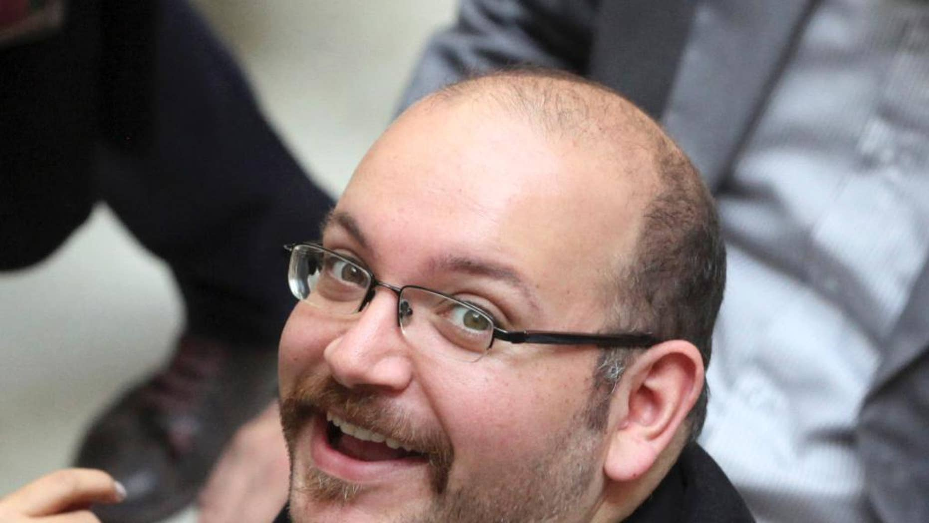 FILE - In this photo April 11, 2013 file photo, Jason Rezaian, an Iranian-American correspondent for the Washington Post, smiles as he attends a presidential campaign of President Hassan Rouhani in Tehran, Iran. The brother of the detained Washington Post correspondent said Wednesday, Feb. 18, 2015 that a new lawyer chosen by the family has been unable to meet with the Iranian-American journalist to complete formalities that would allow him to represent him.(AP Photo/Vahid Salemi, File)