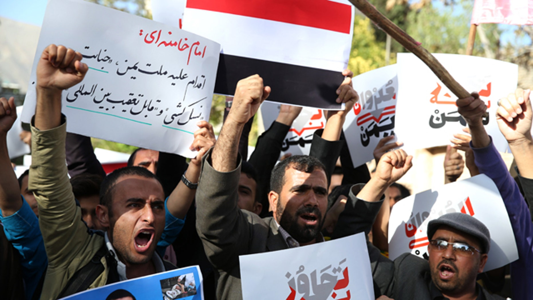 April 13, 2015: Yemeni expatriates and Iranians chant slogans during a protest against the Saudi-led coalition strikes on Yemen, in front of the Saudi Embassy in Tehran. (AP Photo/Ebrahim Noroozi)