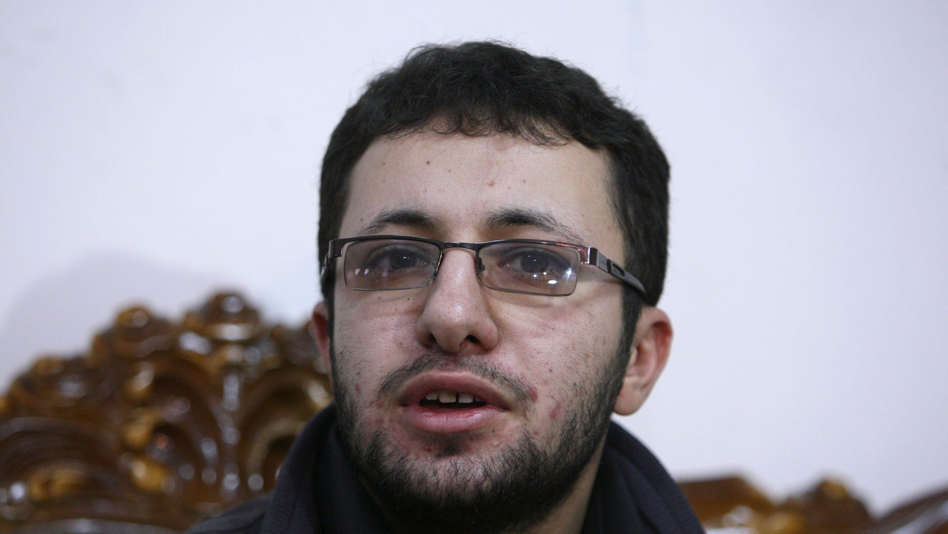 Iranian Sajjad Qaderzadeh, whose mother, Sakineh Mohammadi Ashtiani, has been sentenced to death by stoning for adultery, speaks with the media in a news briefing in the northwestern city of Tabriz, Iran, Saturday, Jan. 1, 2011. Ashtiani's sentence of death by stoning, which Iran has put on hold, has brought harsh condemnation from the U.S., the European Union and rights groups who are demanding Tehran stay the execution. It has further strained Iran's relations with world powers, already tense over the country's disputed nuclear program.