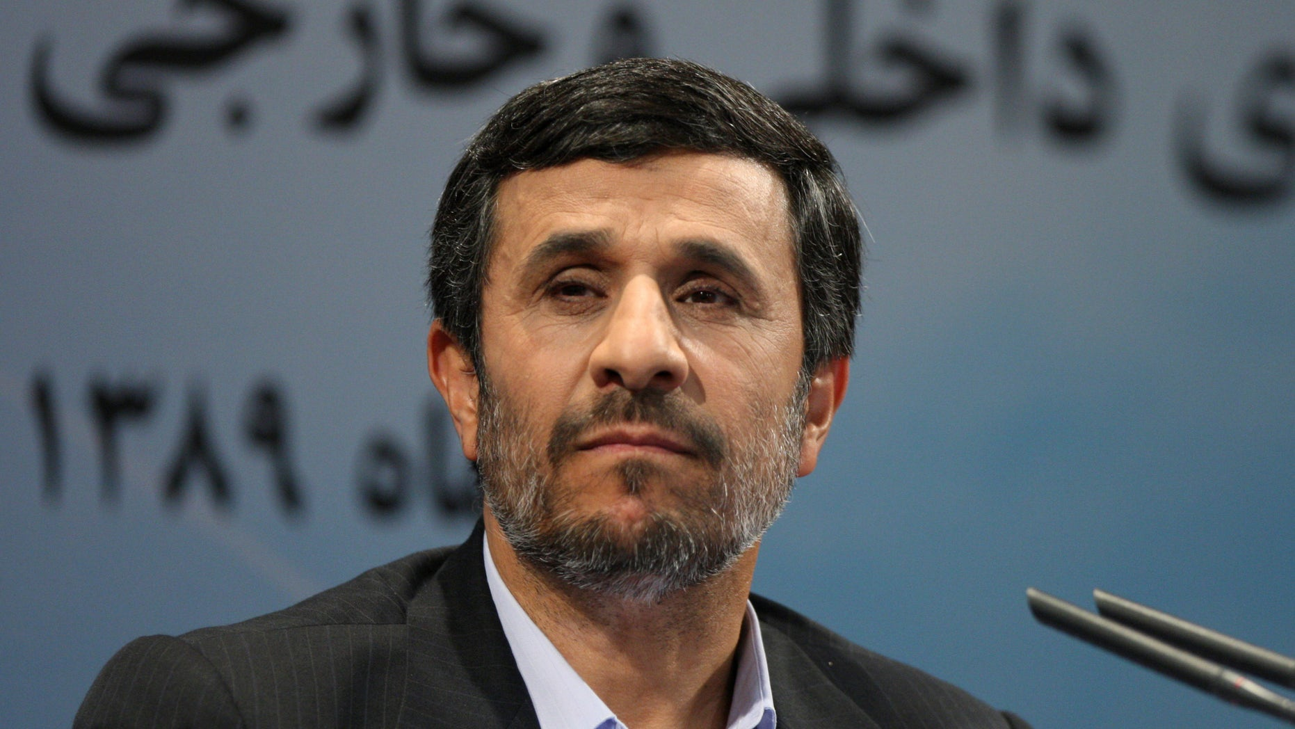 Iranian president Mahmoud Ahmadinejad shown here Nov. 29, listens to a question during his press conference in Tehran, Iran. Ahmadinejad was jeered when he said in a speech at Colombia University that homosexuality did not exist in Iran.