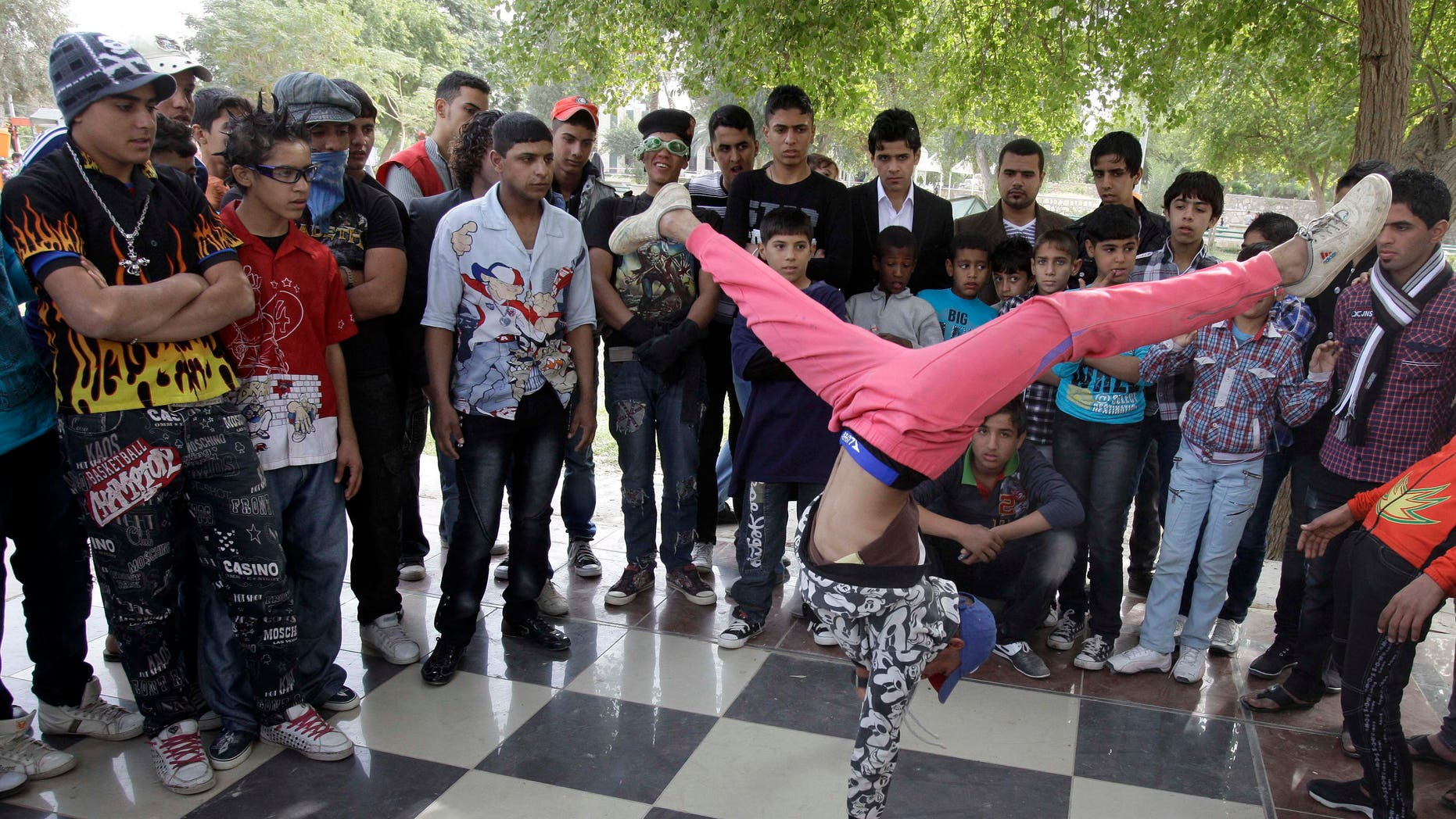 Nov. 10, 2011: An Iraqi boy dances to hip hop music in Baghdad, Iraq. After more than eight years in Iraq, the departing American military's legacy includes a fledgling democracy, bitter memories of war, and for the nation's youth, rap music, tattoos and slang.