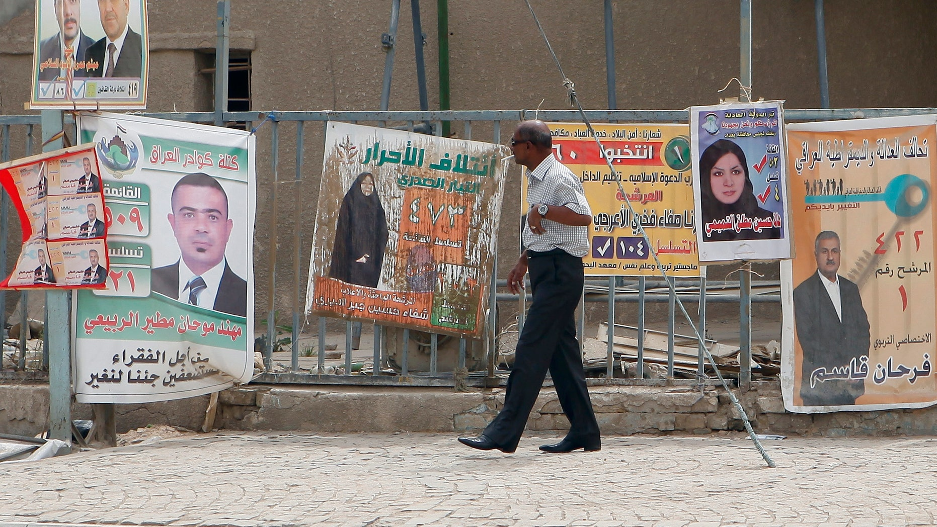 April 13, 2013: A man walks past election posters in Baghdad, Iraq.