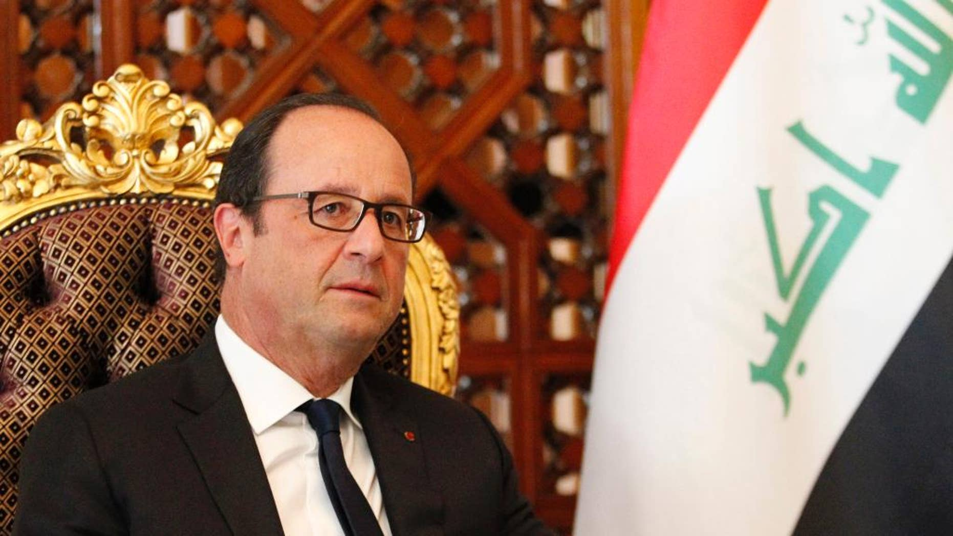 French President Francois Hollande is seen after his arrival at Baghdad Airport in Baghdad, Iraq, Friday, Sept. 12, 2014. Hollande expressed his solidarity with Iraq on a visit to Baghdad on Friday, as his country prepares for possible airstrikes with a U.S.-led coalition against extremists who have seized territory around the region. (AP Photo/Thaier Al-Sudani, Pool)