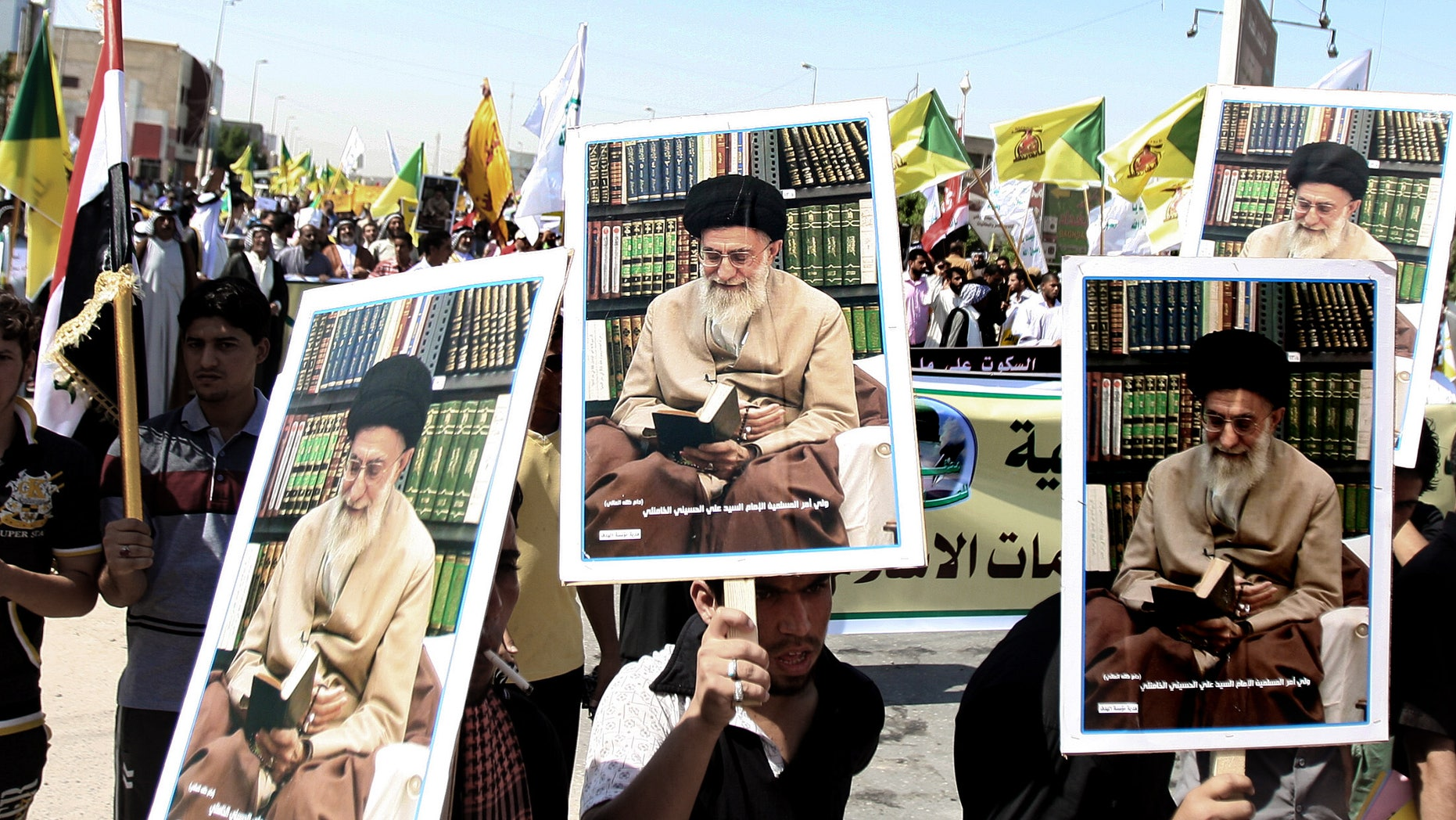 Sept. 21, 2012: In this photo, Iraqis chant slogans as they hold posters of Iran's supreme leader Ayatollah Khamenei during a protest in Basra, 340 miles southeast of Baghdad, Iraq, as part of widespread anger across the Muslim world about a film ridiculing Islam's Prophet Muhammad.