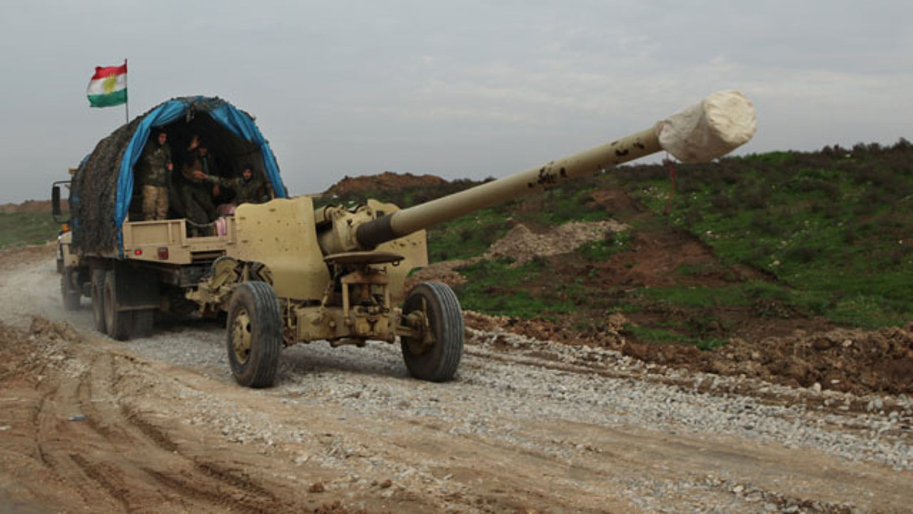 Dec. 19, 2014: Iraqi Kurdish forces tow a howitzer near the front lines on their way to the city of Sinjar, as the Kurdish peshmerga fighters move through Zumar, Iraq. (AP Photo/Zana Ahmed)