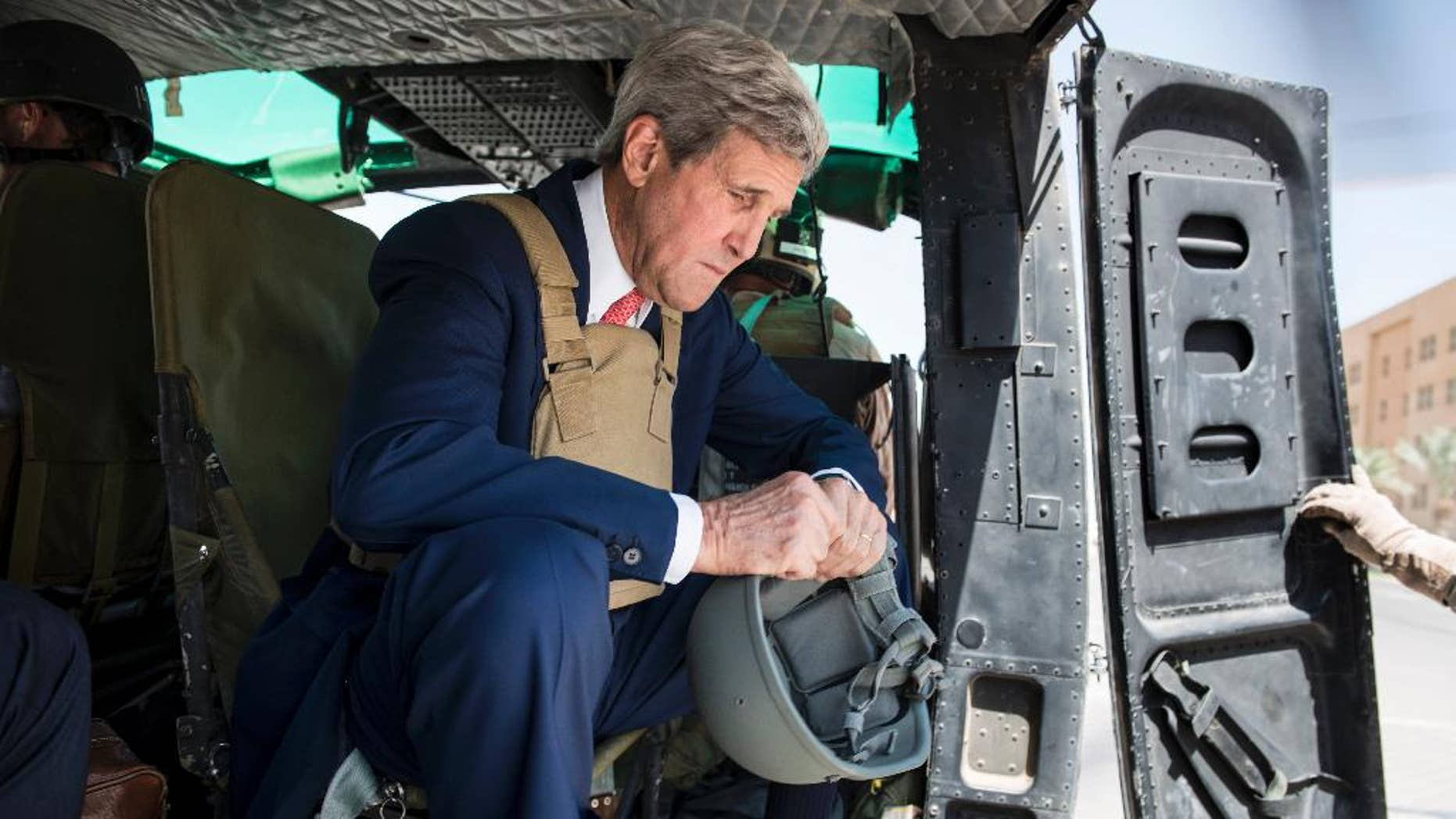 Sept. 10, 2014: U.S. Secretary of State John Kerry arrives in Baghdad, Iraq. Kerry is traveling to the mideast this week to discuss ways to bolster the stability of the new Iraqi government and combat the Islamic State militant group that has taken over large swaths of Iraq and Syria.