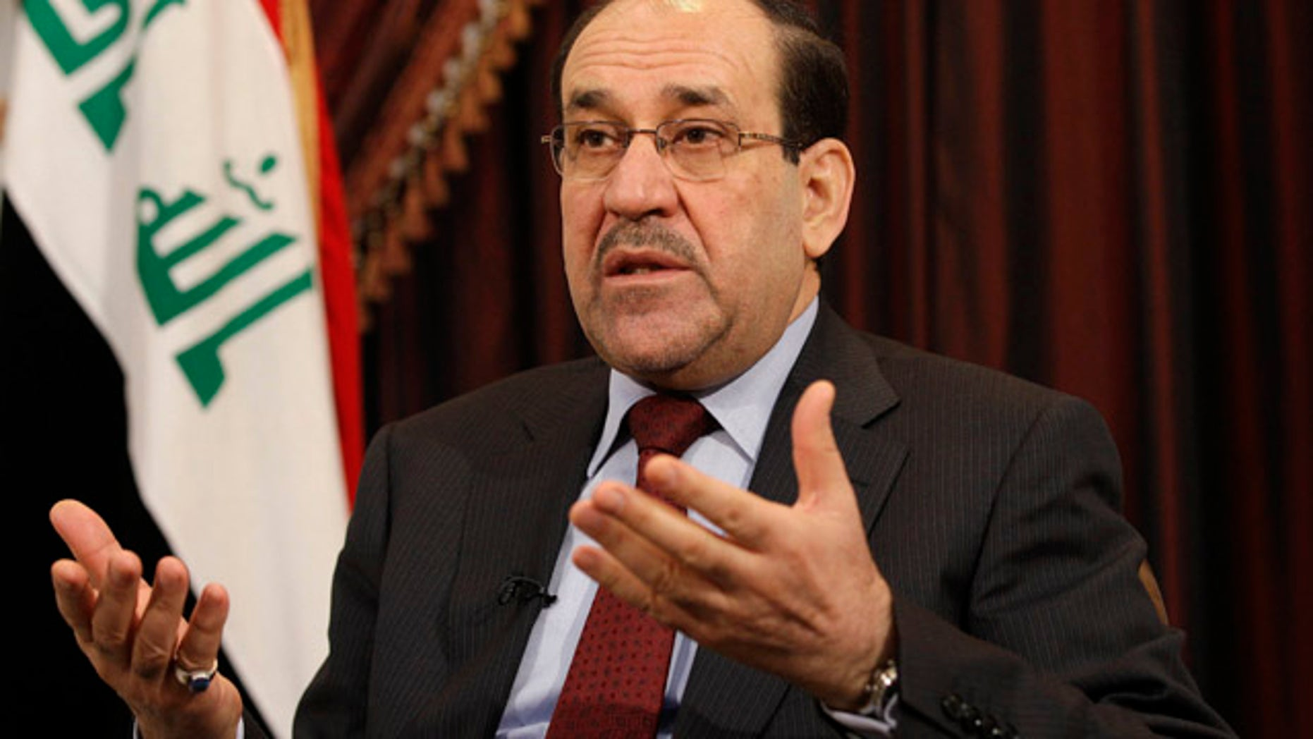 December 3, 2011: Iraq's Shiite Prime Minister Nouri al-Maliki is seen during an interview with The Associated Press in Baghdad. (AP Photo/Hadi Mizban, File)
