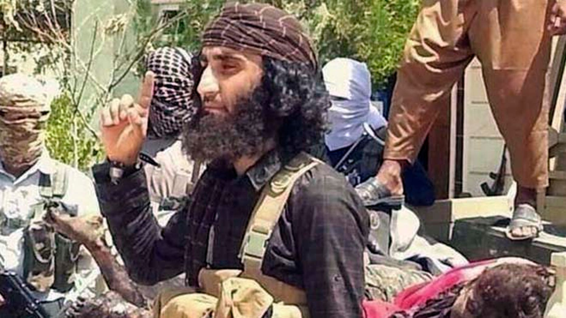 This undated image posted on a militant website shows Abu Khattab al-Kurdi, or Abu Khattab the Kurd, one of the Islamic State group's top military commanders in the offensive on the Syrian city of Kobani. (AP/Jihadis website)