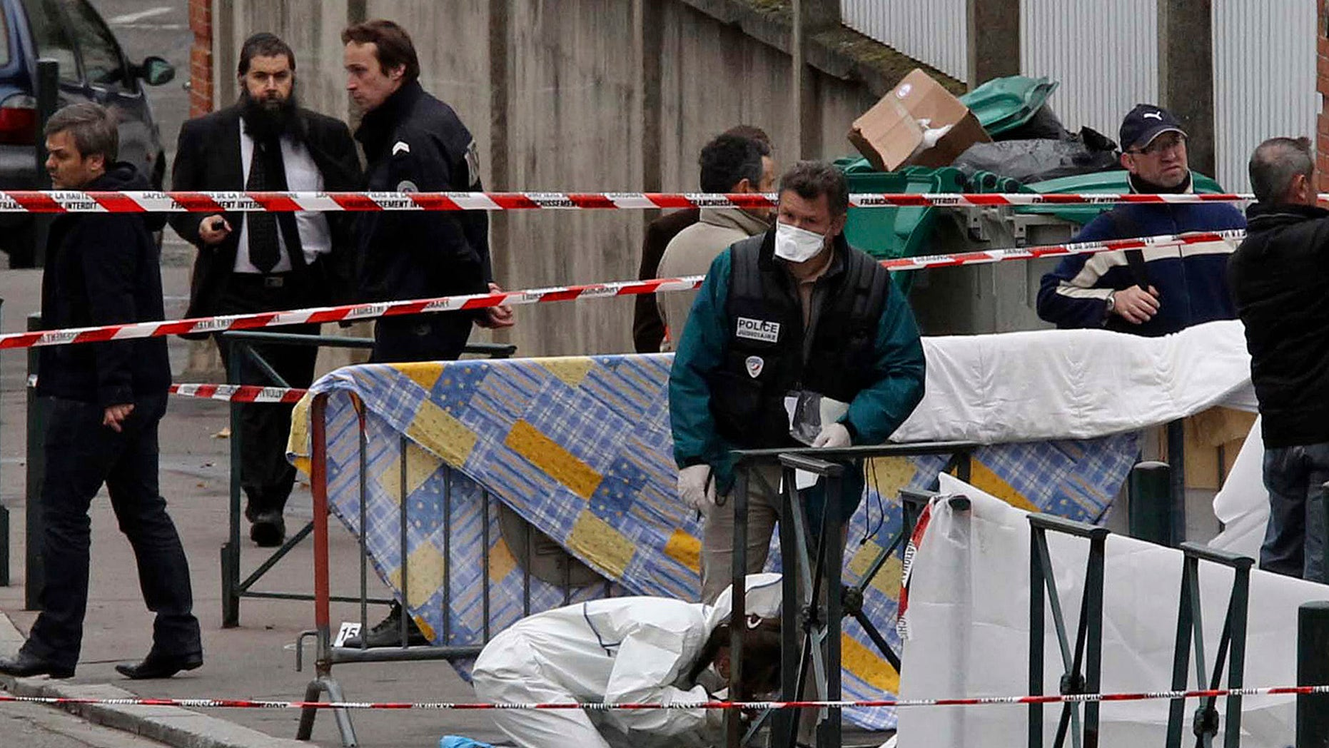 March 19, 2012: In this file photo, police officers gather at the site of a shooting where a gunman opened fire in front of a Jewish school in a city in Toulouse, southwestern France. Israeli researchers and Jewish leaders on Sunday reported 30 percent jump in anti-Semitic violence and vandalism last year.