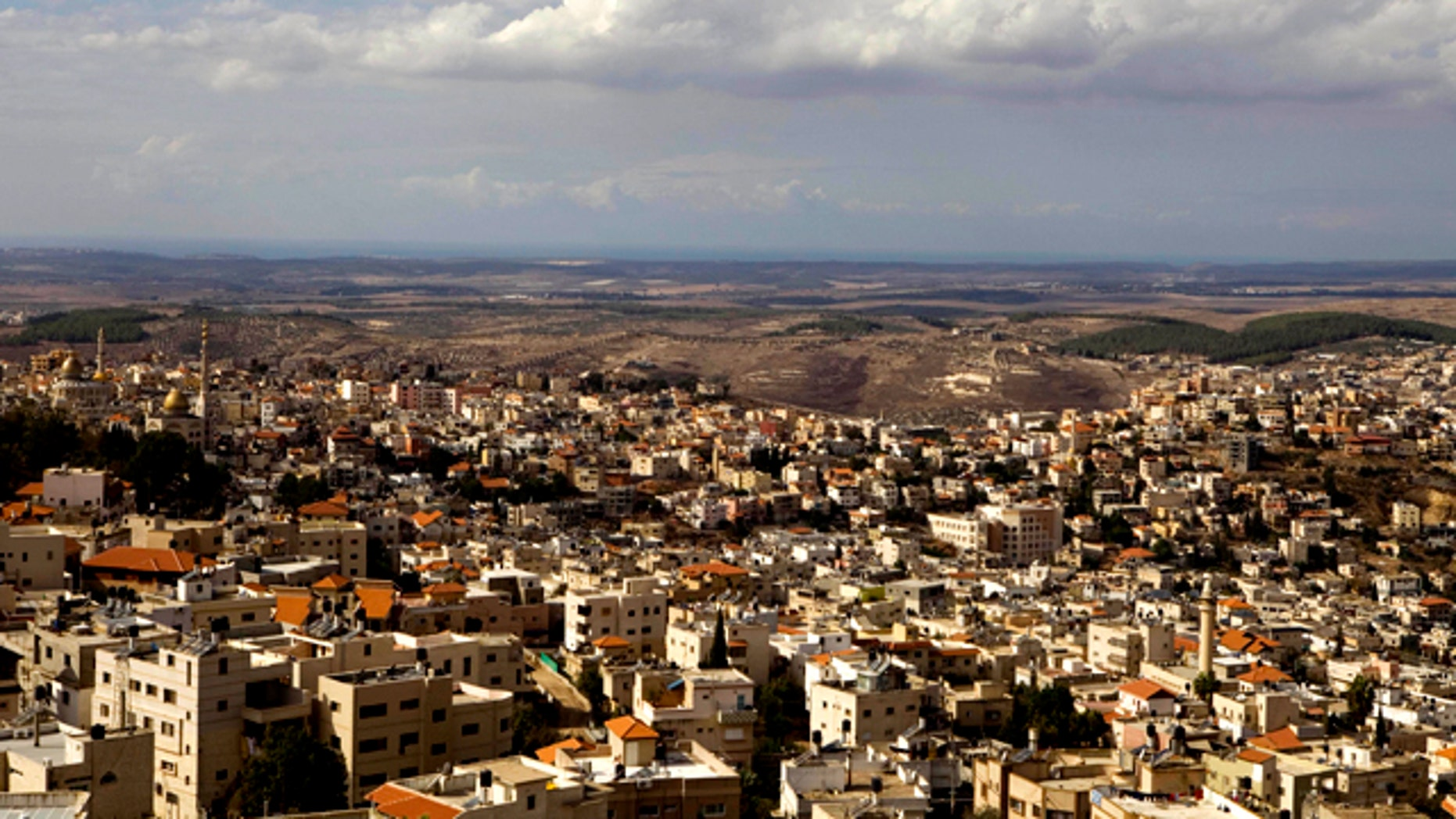 In this photo taken Sunday, Oct. 31, 2010, a general view of the northern Israeli town of Umm el-Fahm. Relations between Israel's dominant Jews and minority Arab citizens have never been cordial. But they now appear to be approaching a particularly low point, and activists warn violence could follow.