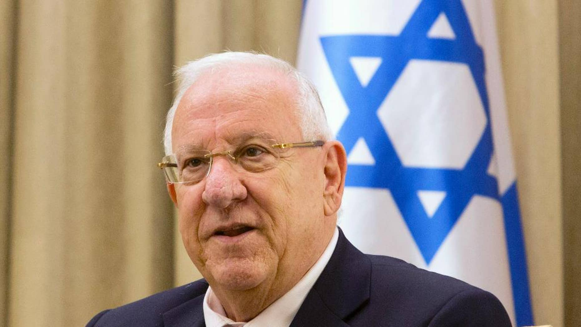 FILE - In this Nov. 3, 2014 file photo, Israel's President Reuven Rivlin, attends a meeting at the President's residence in Jerusalem. A canceled bar mitzvah ceremony for boys with disabilities is highlighting a rift between Israel's Orthodox majority and its more marginal streams of Judaism. President Reuven Rivlin had agreed to hold the ceremony at his residence but later suggested a non-religious event. (AP Photo/Sebastian Scheiner, File)