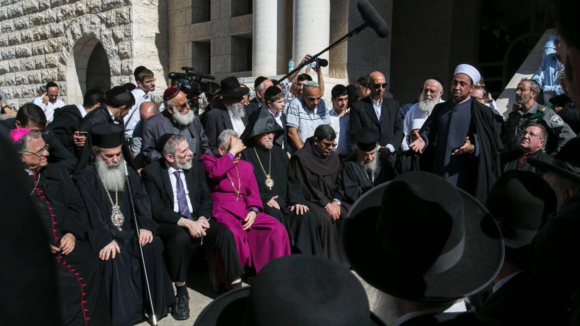 Nov. 19, 2014: Sheikh Samir Assi, the imam of the Al-Jazaar mosque in the northern Israeli city of Acre, addresses Christian, Muslim and Jewish clerics outside the synagogue, where on Tuesday two Palestinians killed five Israelis, in Jerusalem. (AP)