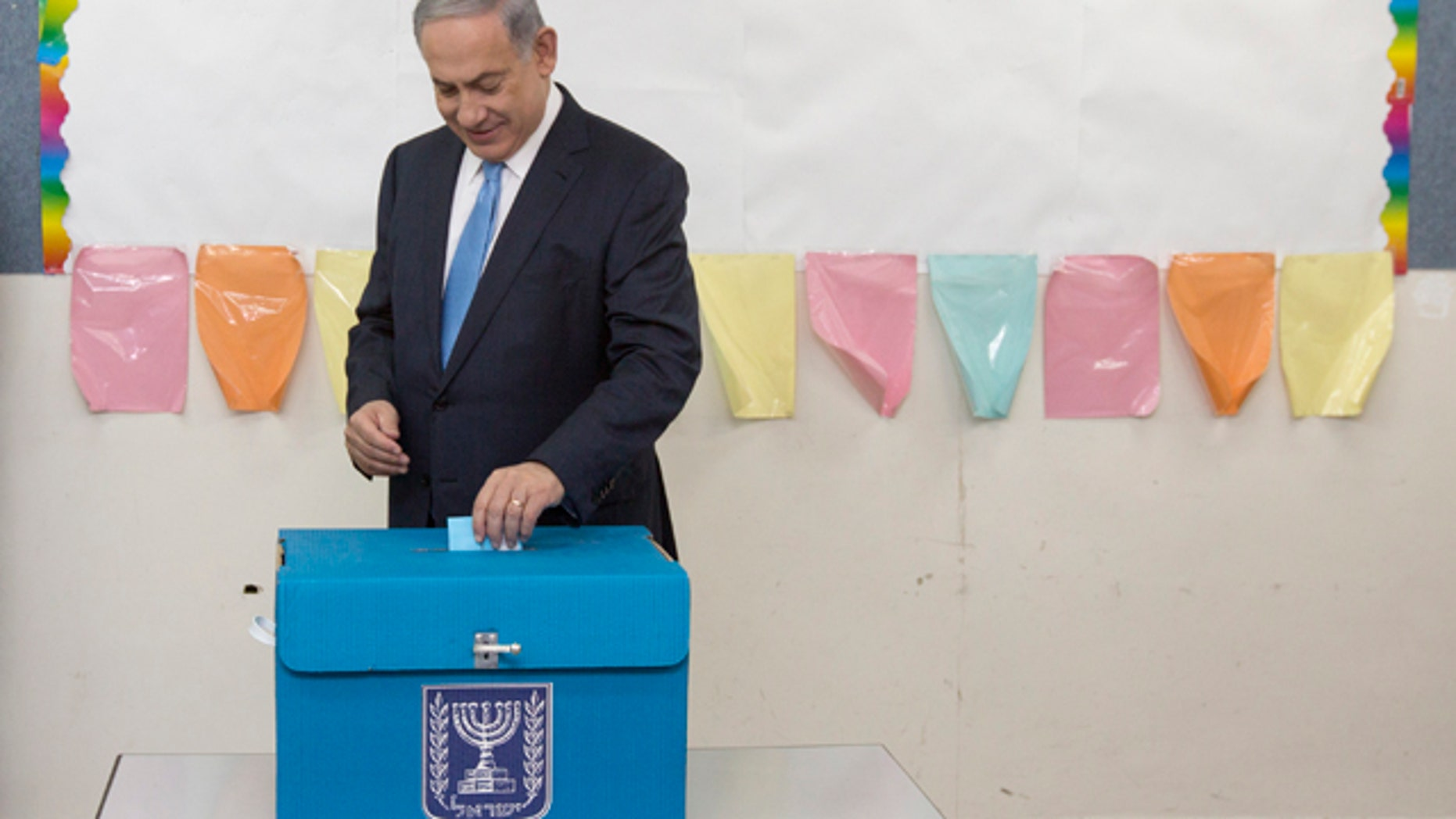 March 17, 2015: Israeli Prime Minister Benjamin Netanyahu casts his vote during Israel's parliamentary elections in Jerusalem. (AP Photo/Sebastian Scheiner, Pool)