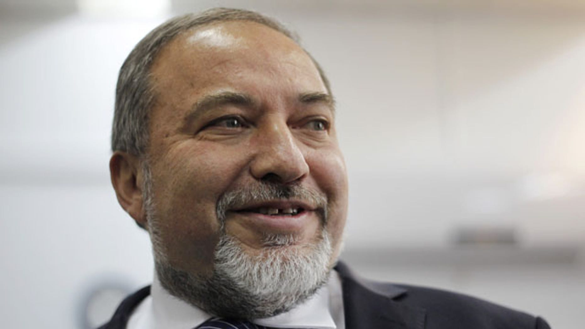 FILE - In this Sunday, Feb. 17, 2013 file photo, Israel's hard-line former Foreign Minister Avigdor Lieberman arrives at a Jerusalem court for the opening hearing of his trial on charges of fraud and breach of trust. (AP Photo)
