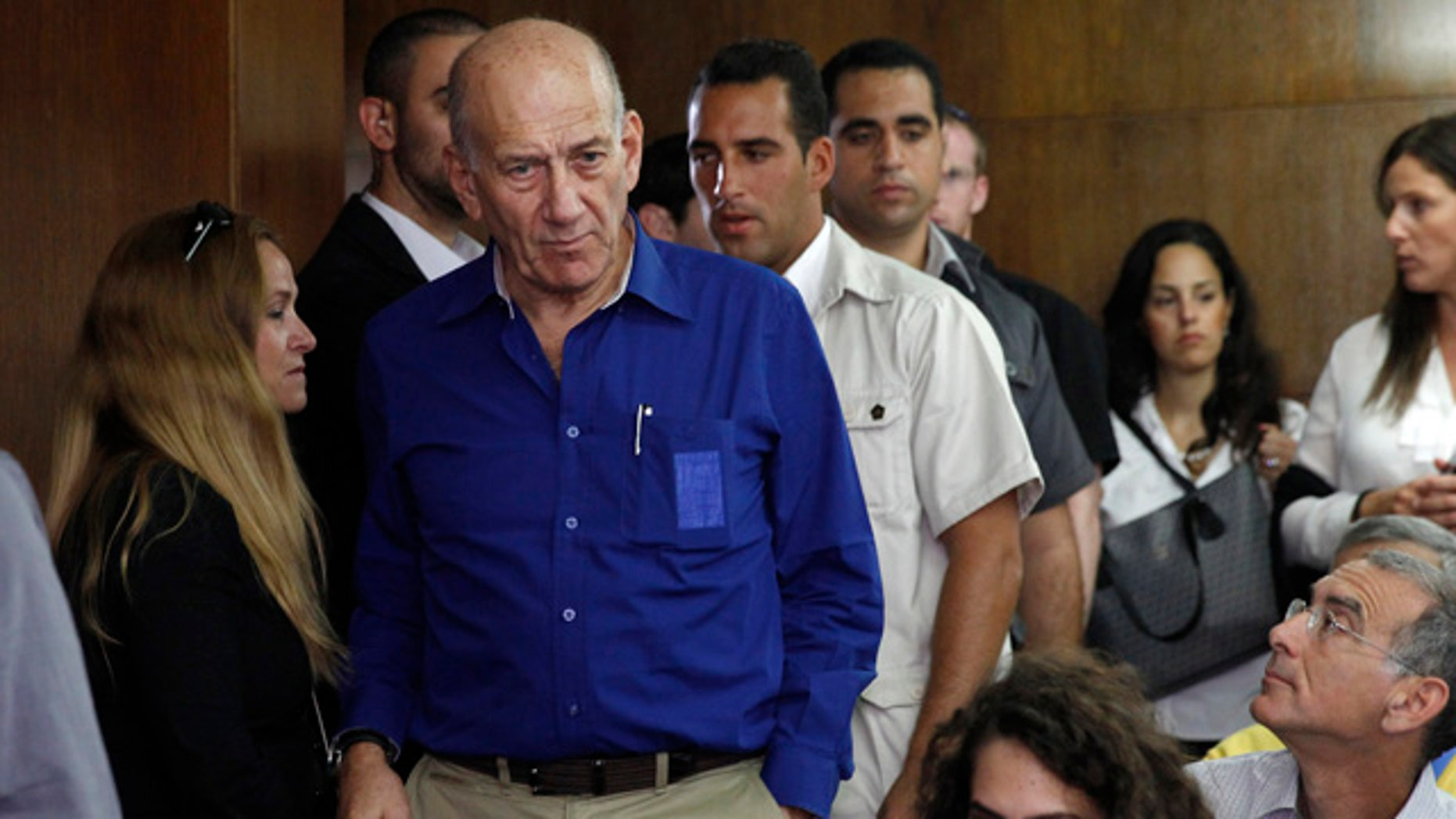 FILE - This May 13, 2014, file photo shows Israel's former Prime Minister Ehud Olmert at the Tel Aviv District Court in Israel. (AP Photo/Finbarr O'Reilly, File)