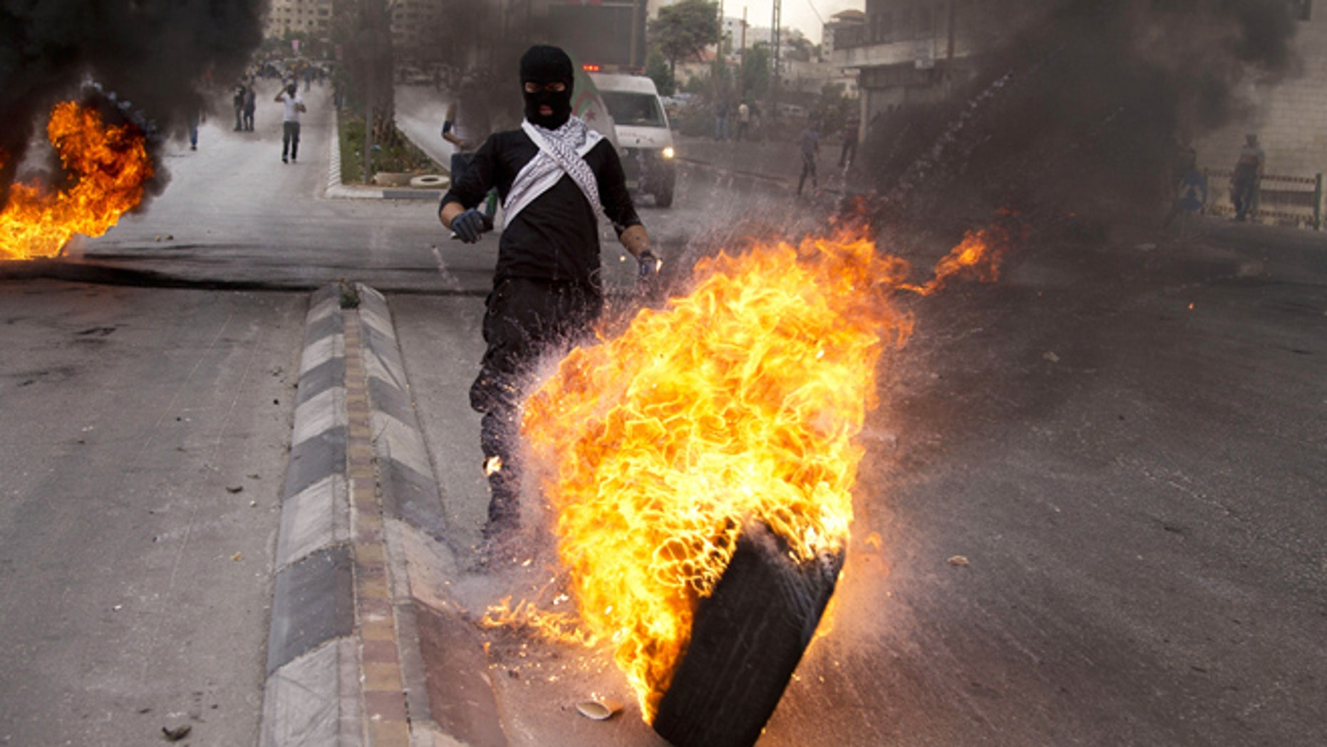 Oct. 23, 2015: Palestinians burn tires during clashes with Israeli troops near Ramallah, West Bank.