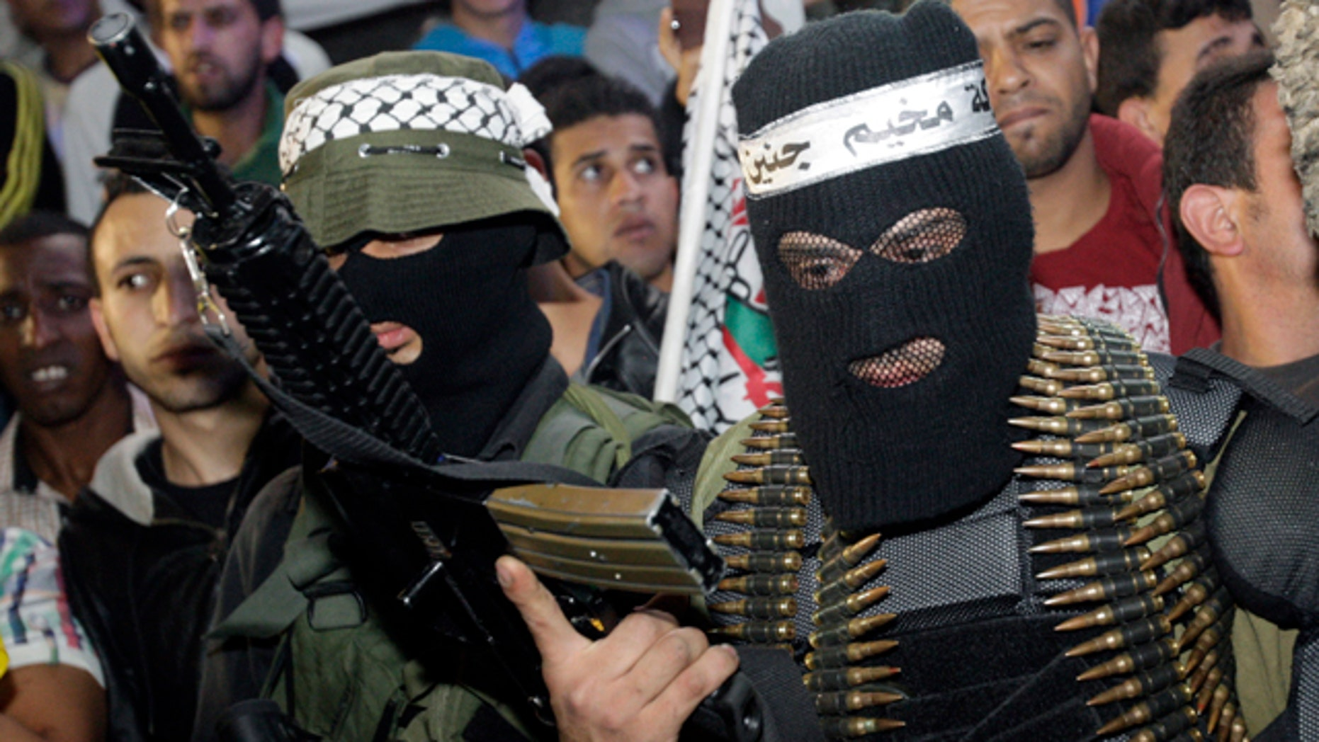 April 7, 2014: A Palestinian militant holds a weapon during a ceremony to mark the 12th anniversary of the Israeli army's 'Defensive Shield' operation in the West Bank refugee camp of Jenin. (AP Photo/Mohammed Ballas)