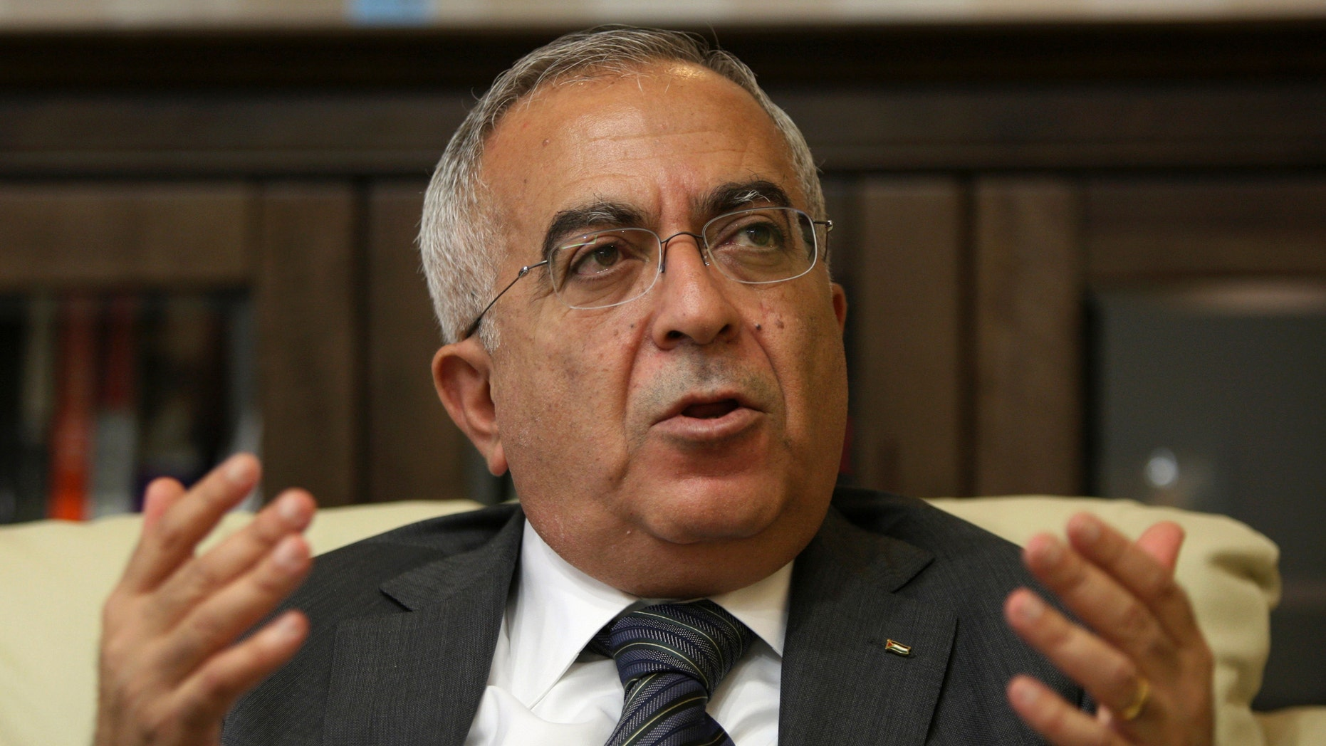 In this June 28, 2011 file photo, Palestinian Prime Minister Salaam Fayyad speaks during an interview with The Associated Press in the West Bank city of Ramallah.