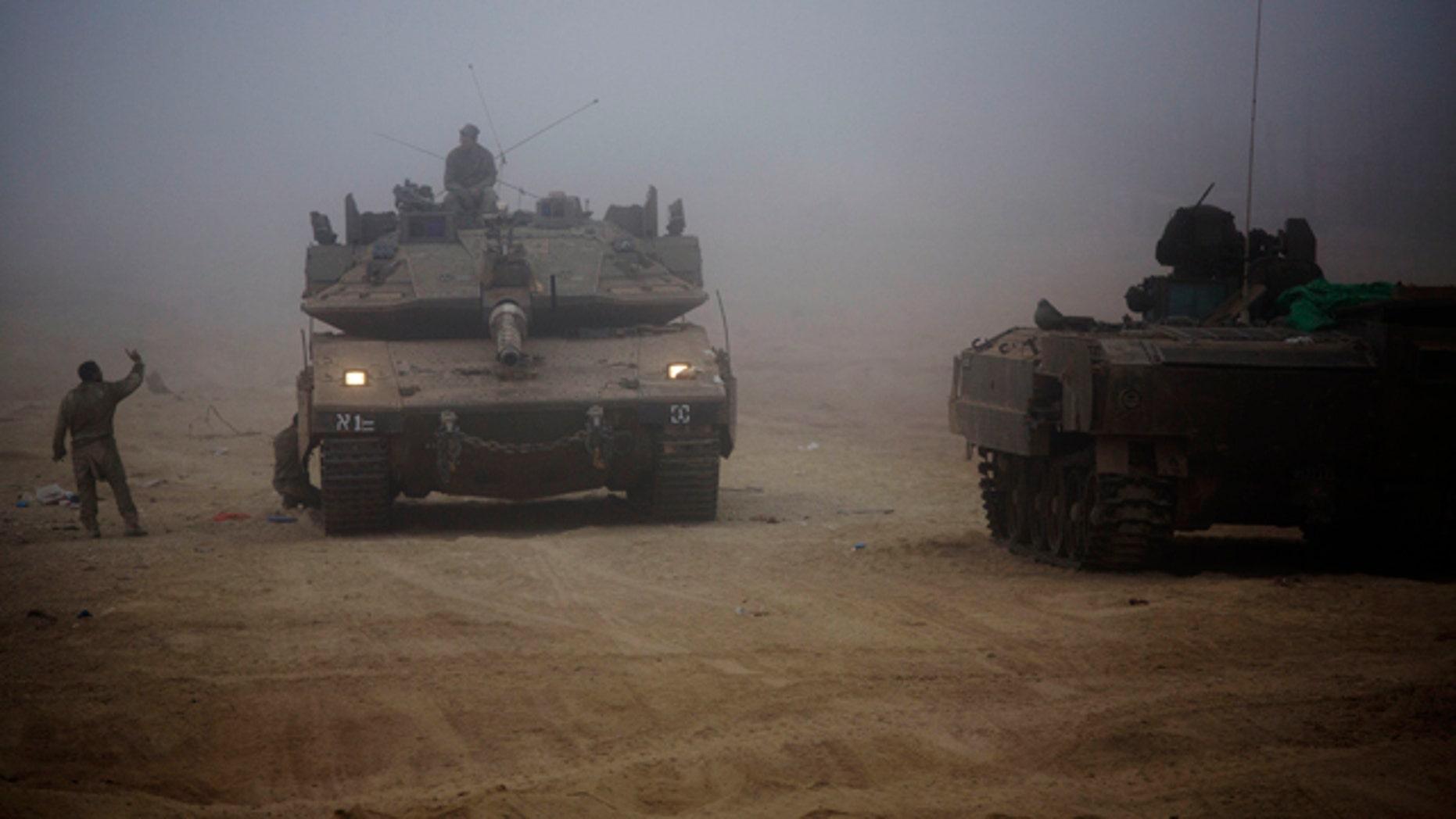 July 24, 2014: An Israeli tank moves through the morning mist near the Israel and Gaza border. (AP Photo/Dusan Vranic)