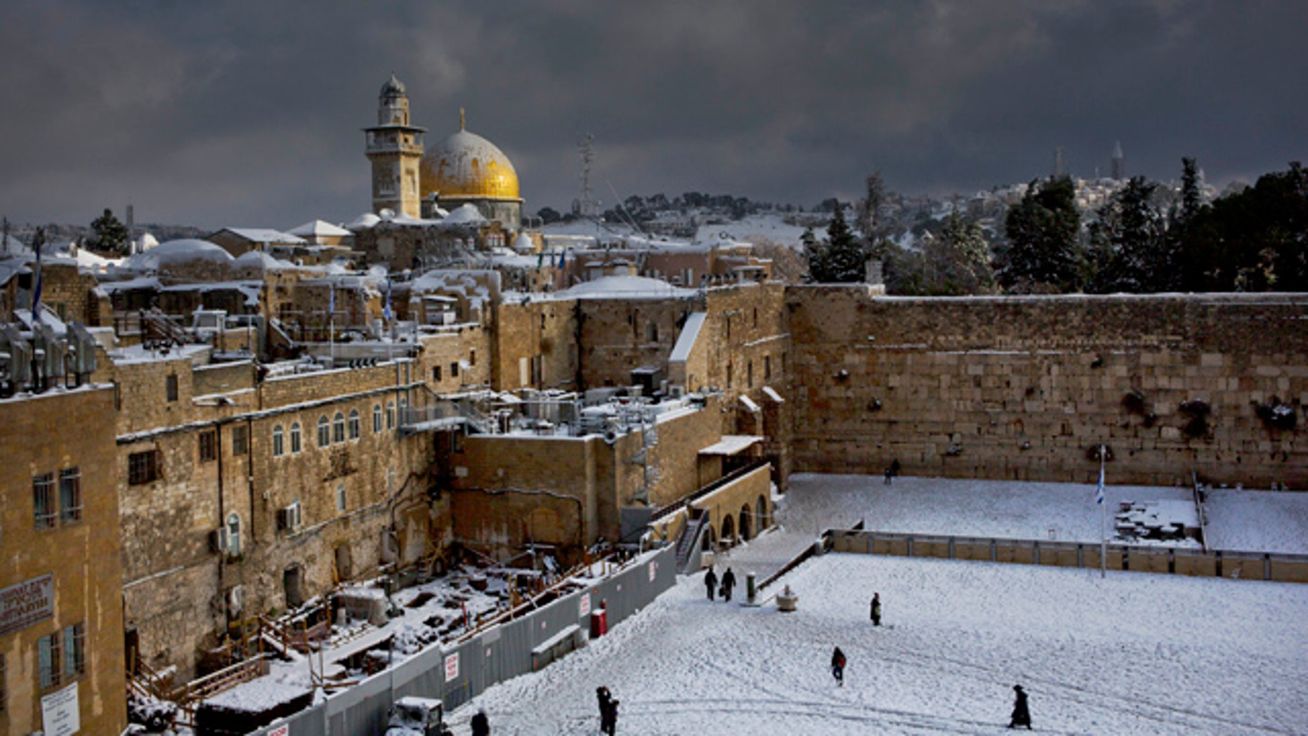 FILE - In this Dec. 13, 2013 file photo, the Western Wall, right, and the gilded Dome of the Rock, among the holiest sites for Jews and Muslims, are covered in snow. (AP Photo/Dusan Vranic, File)