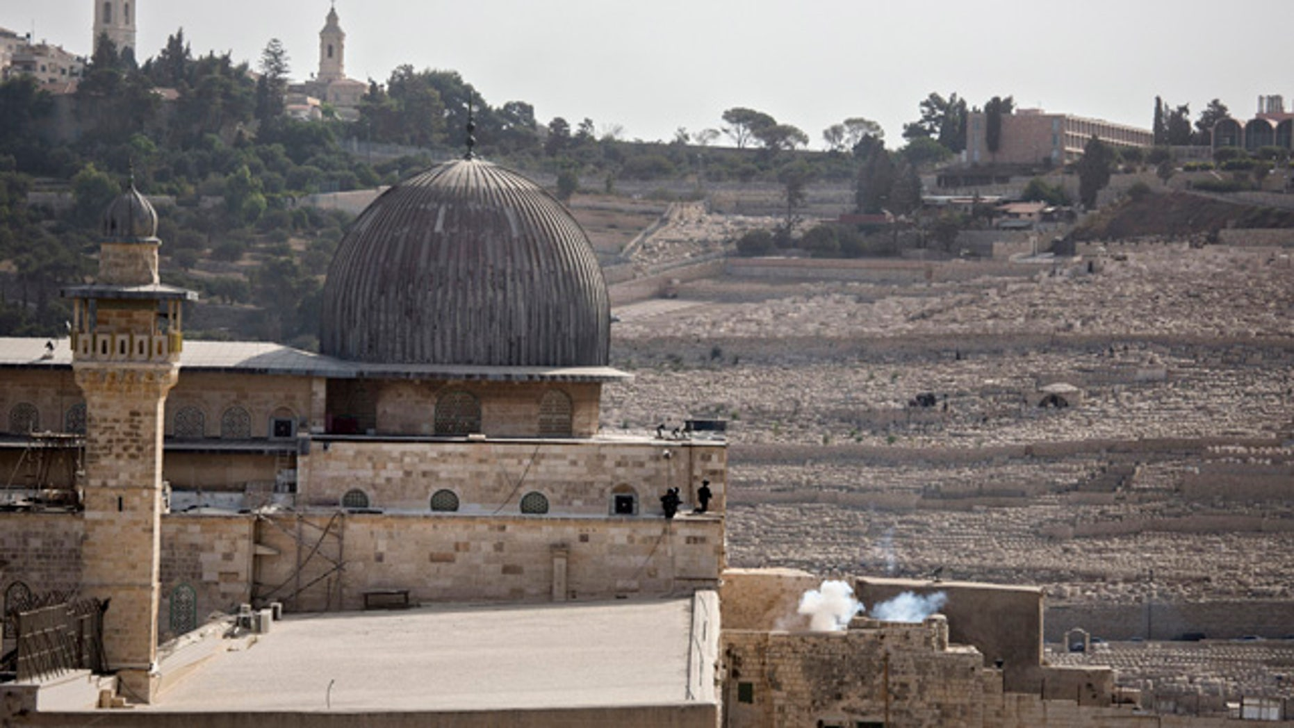 Sept: 13, 2015: Israeli border police are seen inside the Al Aqsa Mosque compound after firing teargas or a smoke grenade in Jerusalem's Old City. (AP Photo/Tsafrir Abayov)
