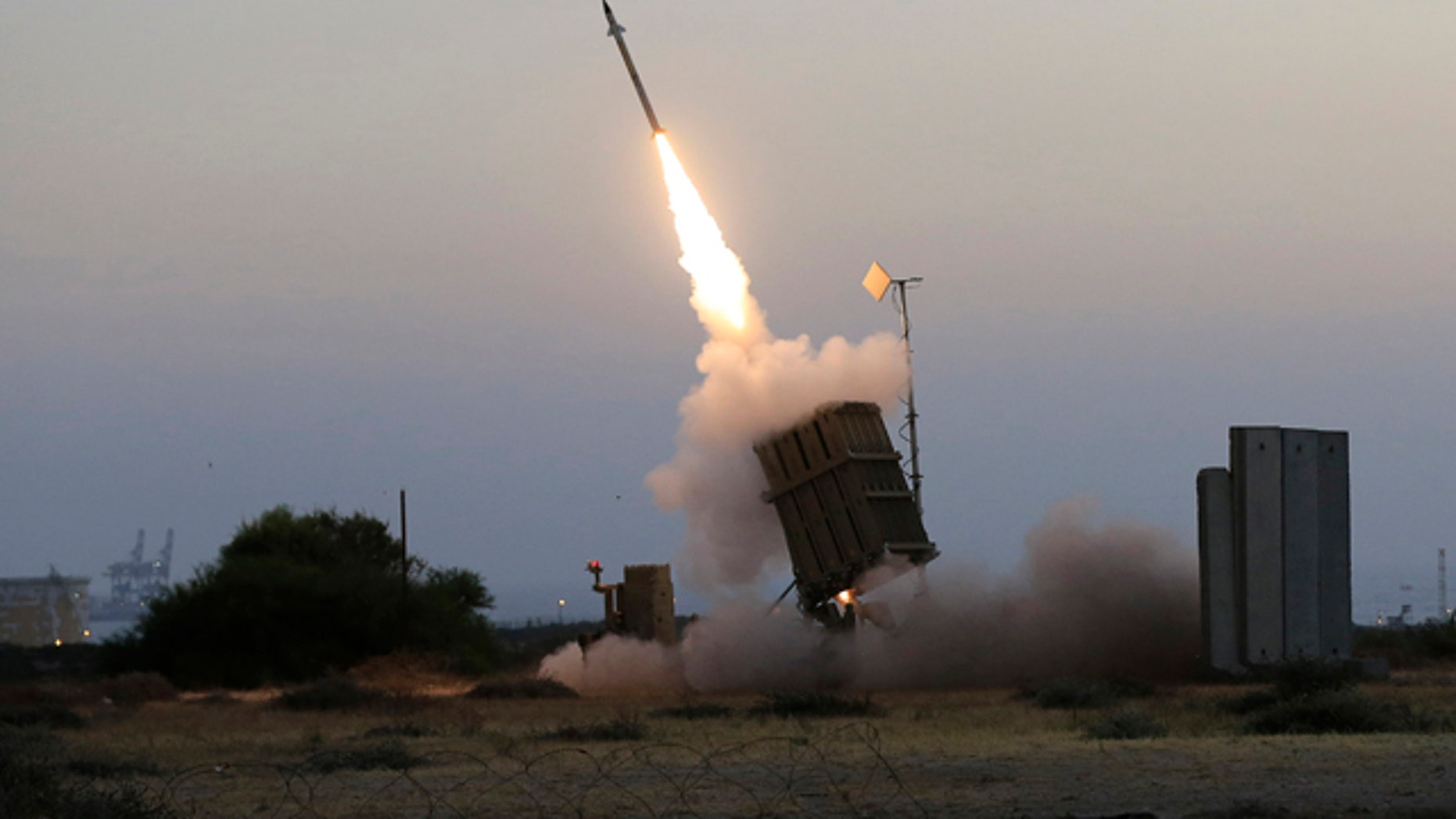 July 5, 2014: An Iron Dome air defense system fires to intercept a rocket from Gaza Strip in the costal city of Ashkelon, Israel. (AP Photo/Tsafrir Abayov)