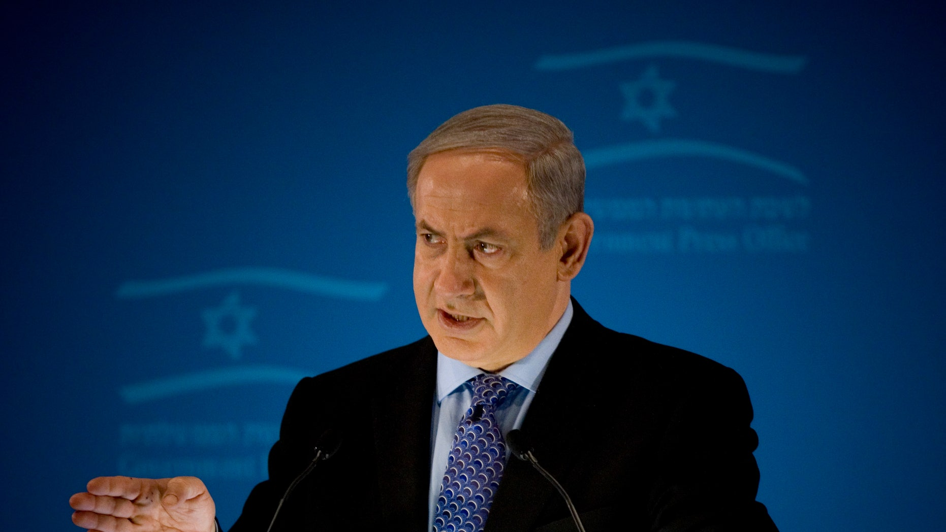 Jan. 11: Israeli Prime Minister Benjamin Netanyahu delivers a statement to members of the foreign press in Jerusalem. Netanyahu insists that Iran will not stop its nuclear program unless economic sanctions are backed with a 'credible military option.'