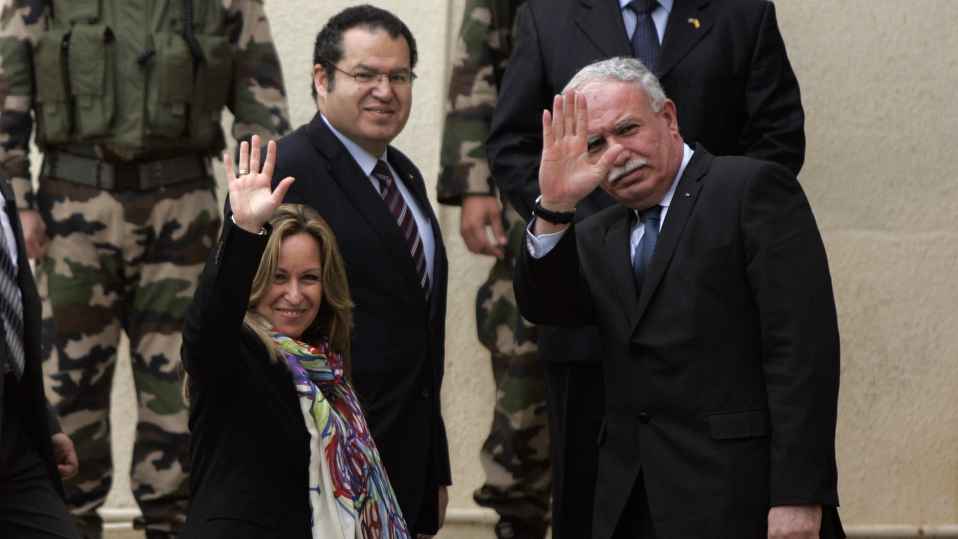 Feb. 9: Spain's Foreign Minister Trinidad Jimenez, left, waves to media members with her Palestinian counterpart Riad Malki, right, as they arrive for a meeting with Palestinian President Mahmoud Abbas, not seen, in the West Bank city of Ramallah.