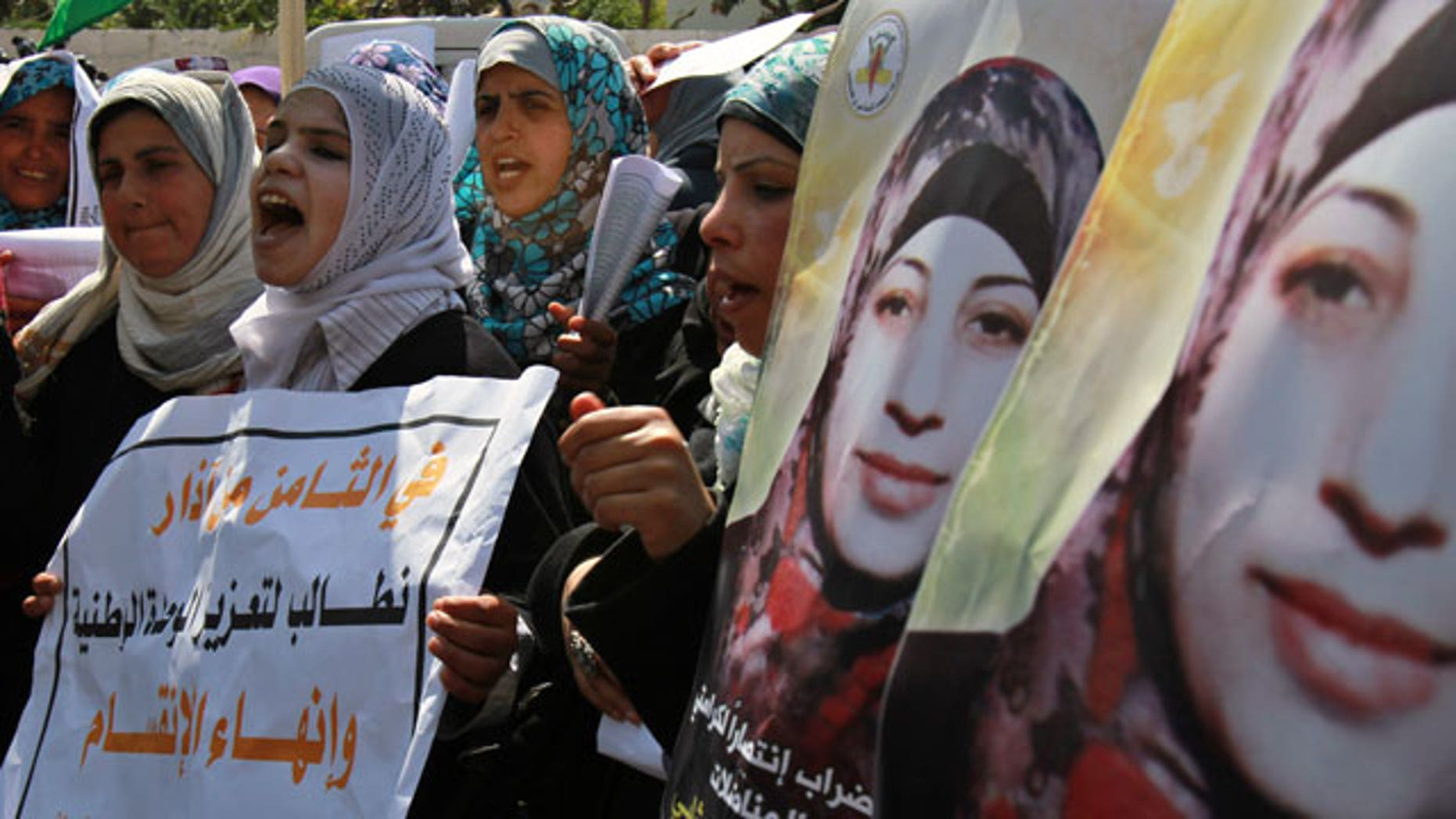 Mar. 8, 2012: Palestinian women take part in a protest in solidarity with Hana Shalabi, a Palestinian prisoner jailed in Israel and who has been on hunger strike for 22 days, and marking International Women's Day in front of the International Red cross offices in Gaza City.