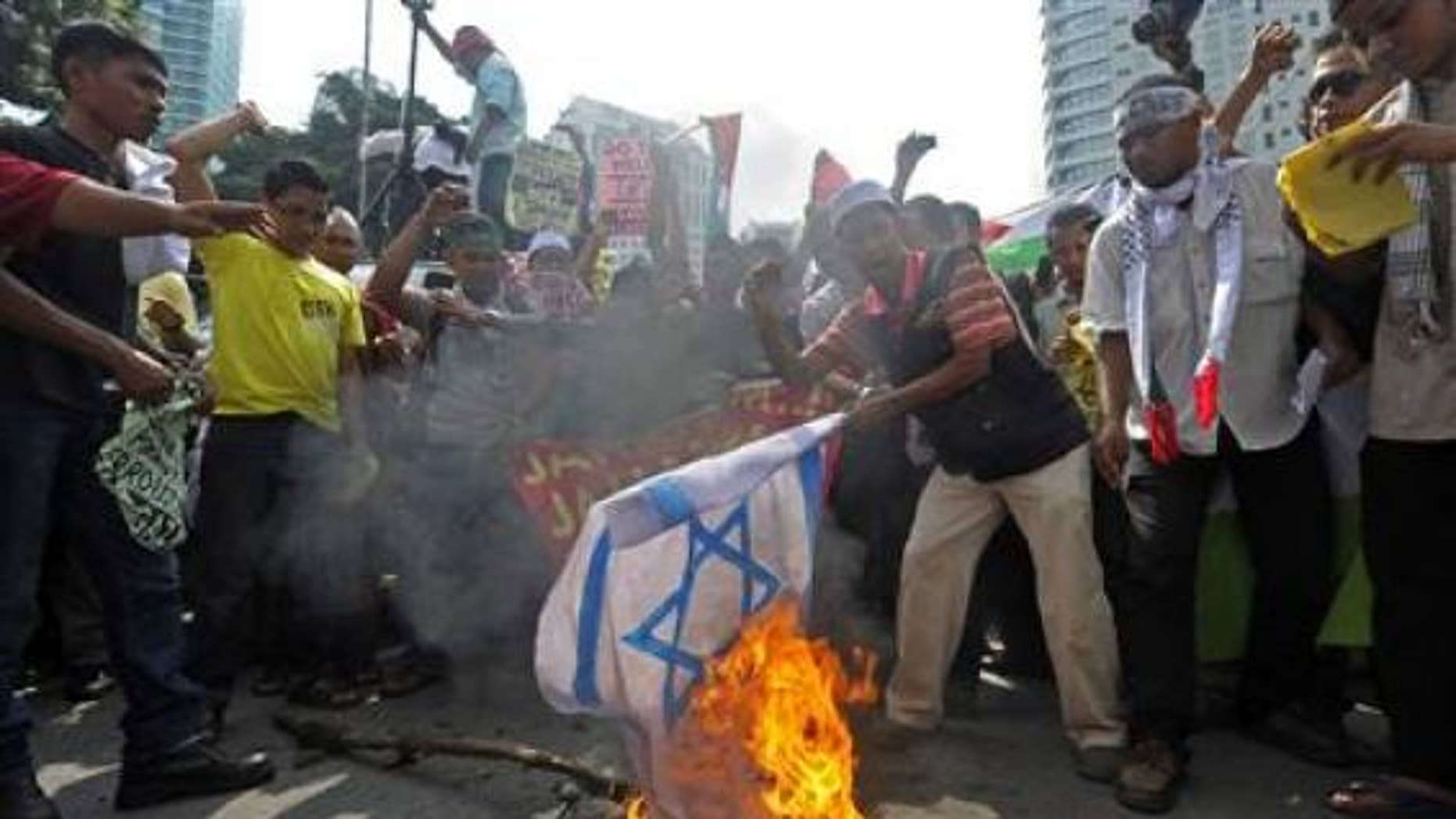 Friday: In Malaysia, a demonstrator set fire to an Israeli national flag near the U.S. embassy to protest Israel's raid of a Gaza-bound flotilla.