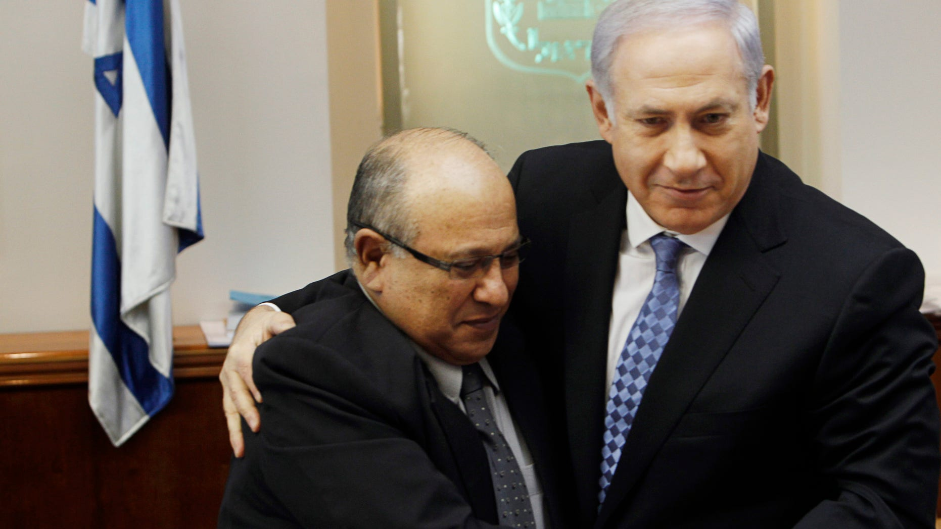 In this Jan. 2, 2011 file photo, Israel's Prime Minister Benjamin Netanyahu, right, hugs Meir Dagan, then outgoing Mossad chief, after thanking him at the beginning of the weekly cabinet meeting in Jerusalem. Israeli media on Thursday, 2 June, 2011, cite the recently retired Mossad chief Meir Dagan as saying there are no plans to attack Iran within the next two years. (AP/File)