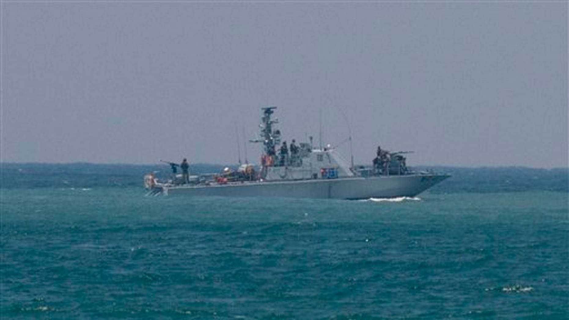 July 19: An Israeli military naval ship sails off the port of Ashdod, Israel,Tuesday. The Israeli military said Tuesday it has made initial contact with a ship attempting to break Israel's blockade of the Gaza Strip and warned the vessel it is approaching an off-limits naval zone.