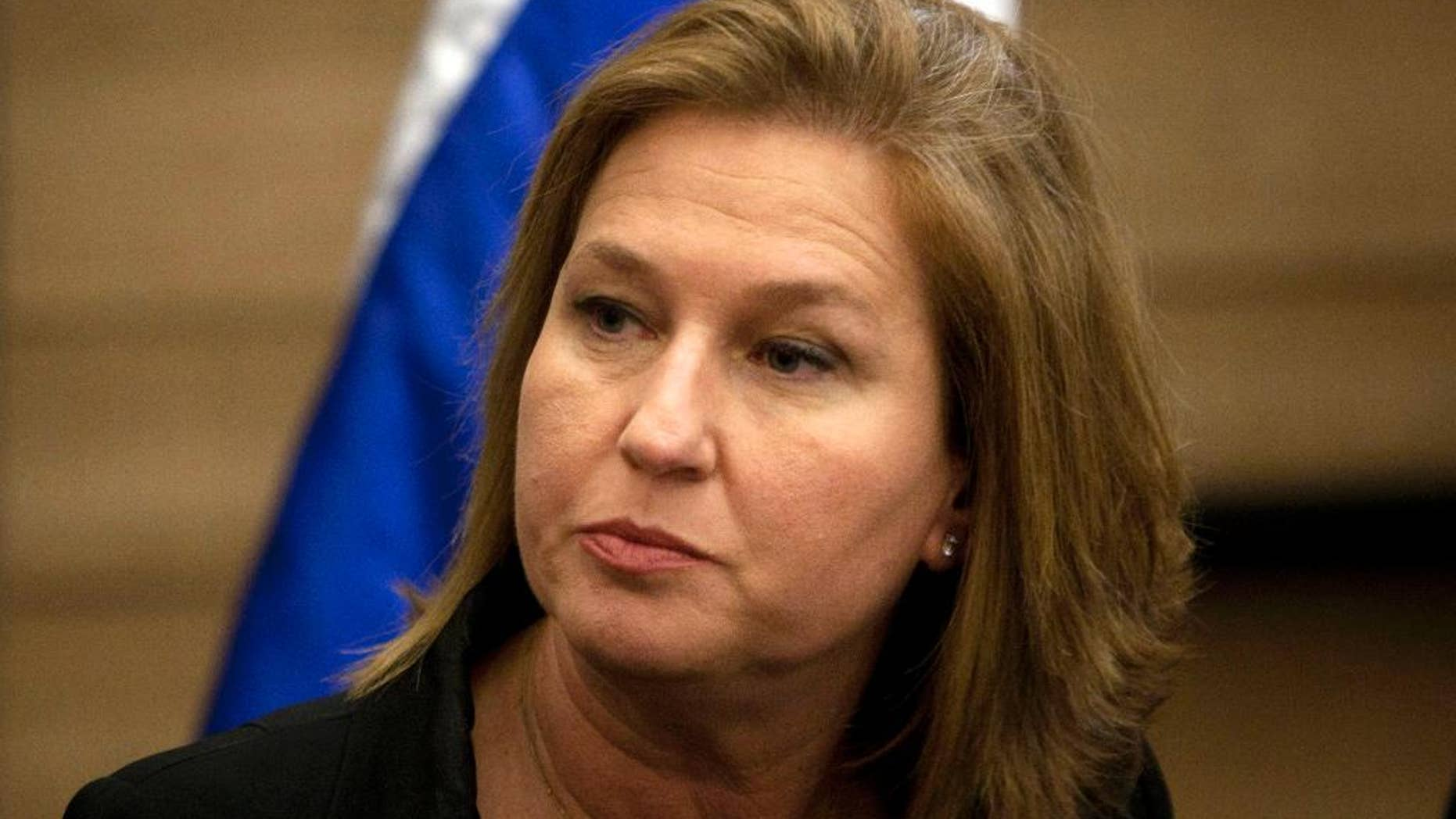 "FILE - In this Wednesday, Nov. 30, 2011 file photo, former Israeli Foreign Minister Tzipi Livni attends a news conference at the Knesset, Israel's parliament, in Jerusalem. Israel's opposition Labor party is joining forces with a former government partner in a bid to unseat Prime Minister Benjamin Netanyahu in the country's coming elections. Labor leader Isaac Herzog announced the alliance with Livni of the Hatnuah party at a press conference on Wednesday, Dec. 10, 2014, featuring the slogan ""Together We Win."" (AP Photo/Sebastian Scheiner, File)"