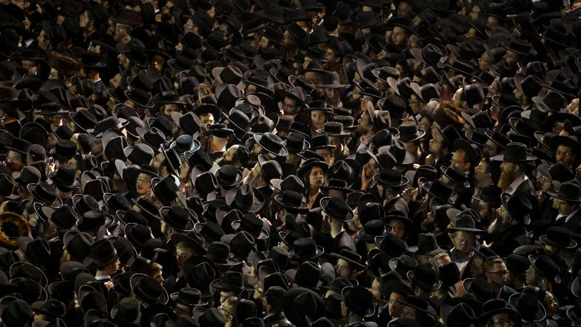 FILE - In this Thursday, May 16, 2013 file photo, thousands of ultra-Orthodox Jews gather near an Israeli Defense Forces recruitment center during a protest against military conscription of yeshiva students, in Jerusalem. The formation of Benjamin Netanyahu's new coalition government has cleared the way for the country's ultra-Orthodox parties to return to power after two years in the opposition. This religious resurgence could have deep implications as they seek to reinstate a system of subsidies and preferential treatment that have long angered the country's secular majority, potentially setting the stage for a new round of culture wars that recently have plagued Israel. (AP Photo/Bernat Armangue, File)