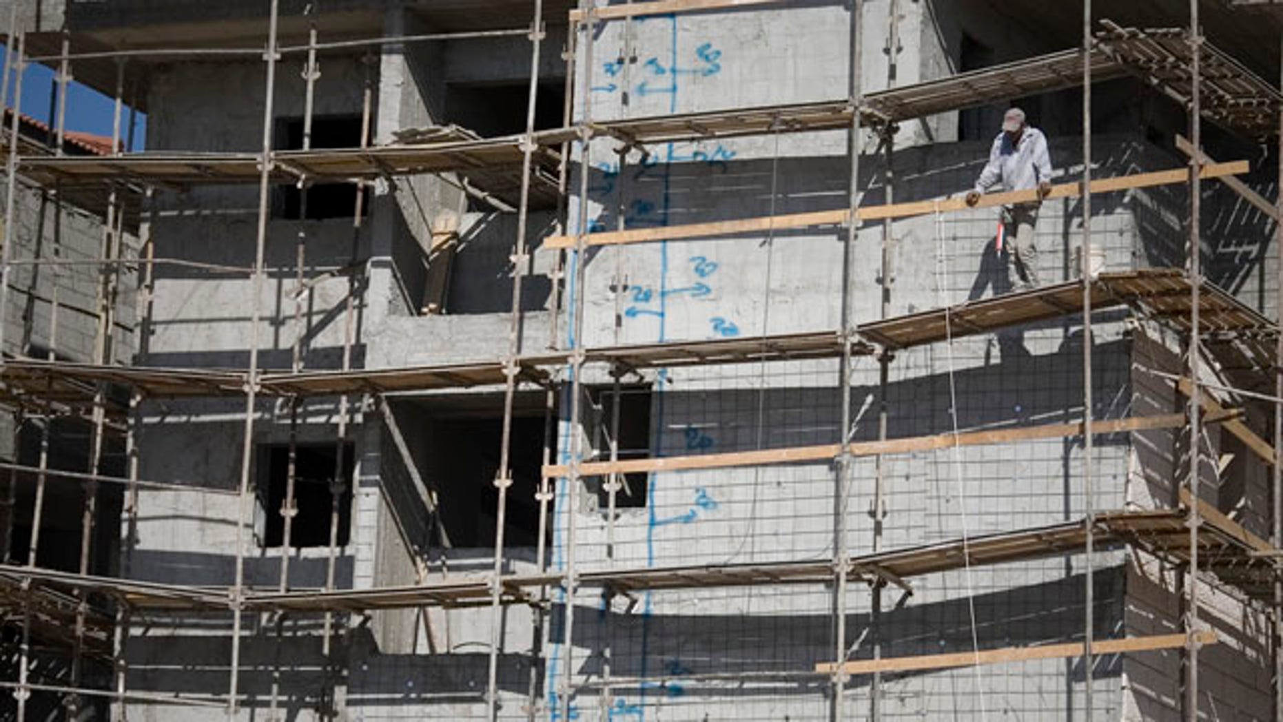 Nov. 9: A construction worker looks on at a site in the West Bank Jewish settlement of Ariel. The official Palestinian news agency said the Palestinian president wants a U.N. Security Council session to discuss such Israeli settlement construction.